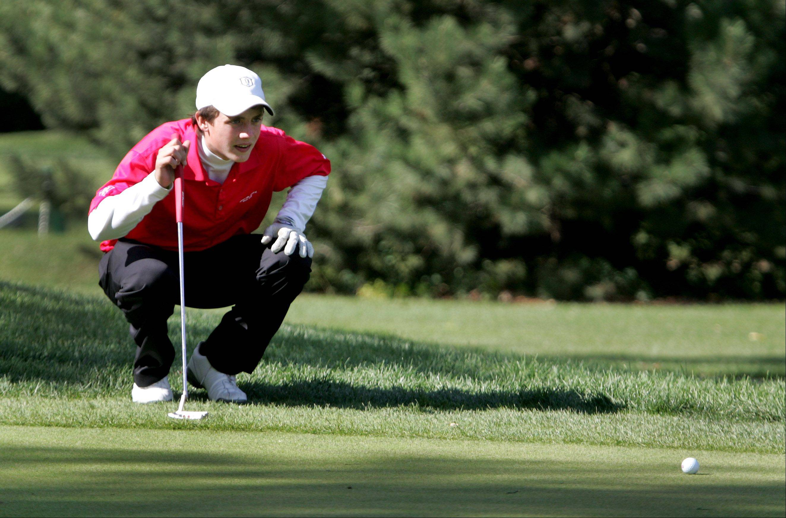 Peter Mandich of Naperville Central lines up a putt on the 6th green during DuPage Valley Conference boys golf at Bartlett Hills Golf course on Thursday.