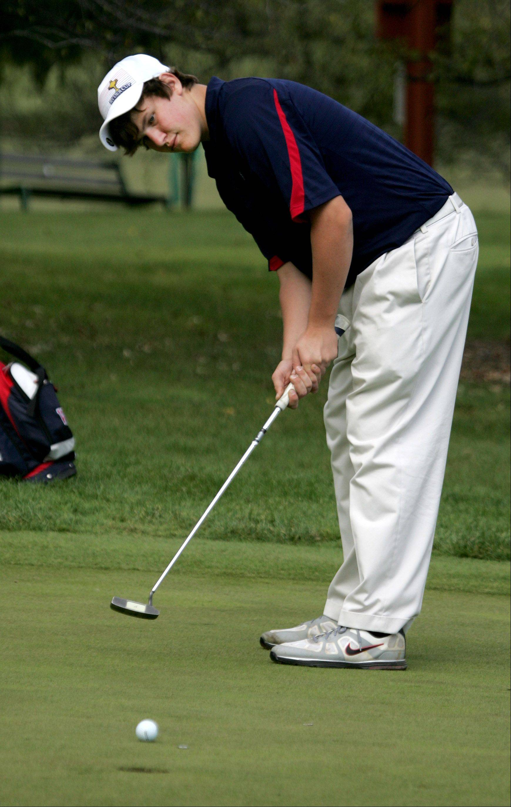 Blake Kauffmann of West Aurora watches his putt on the 18th green during DuPage Valley Conference boys golf at Bartlett Hills Golf course on Thursday.