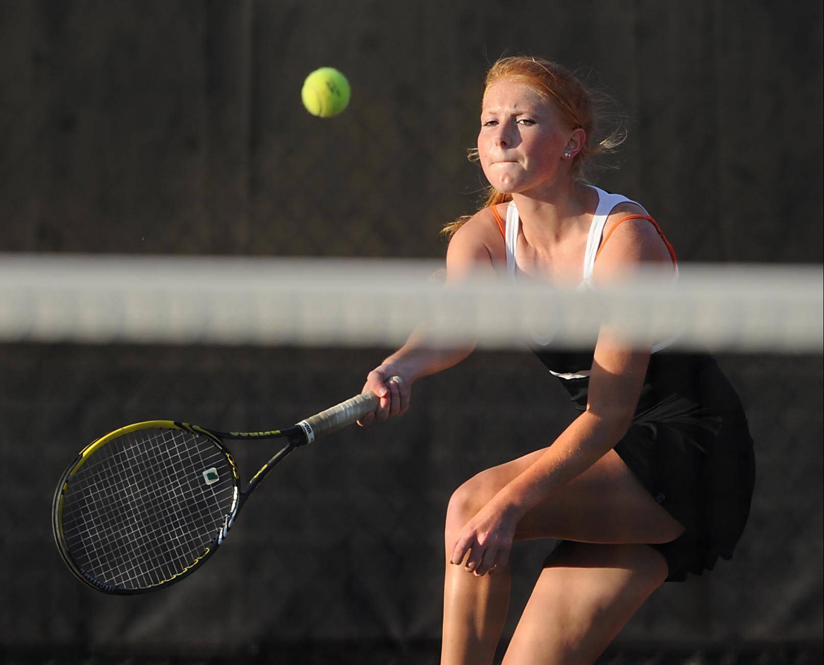 St. Charles East's Jamie Youngberg returns a forehand.