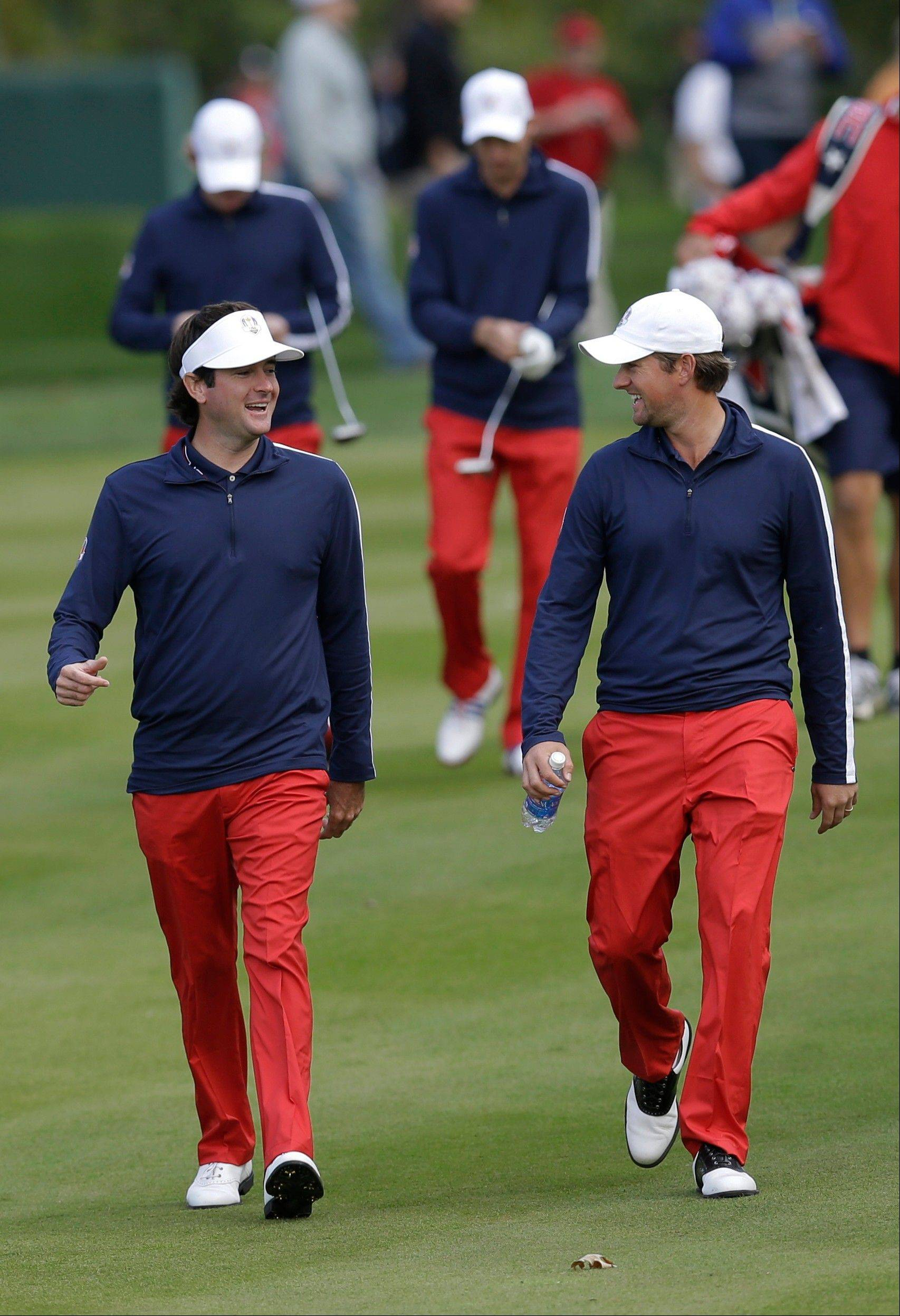 USA's Bubba Watson, left, and Webb Simpson have become good friends on and off the course. Watson won the Masters this year, and Simpson won the U.S. Open.