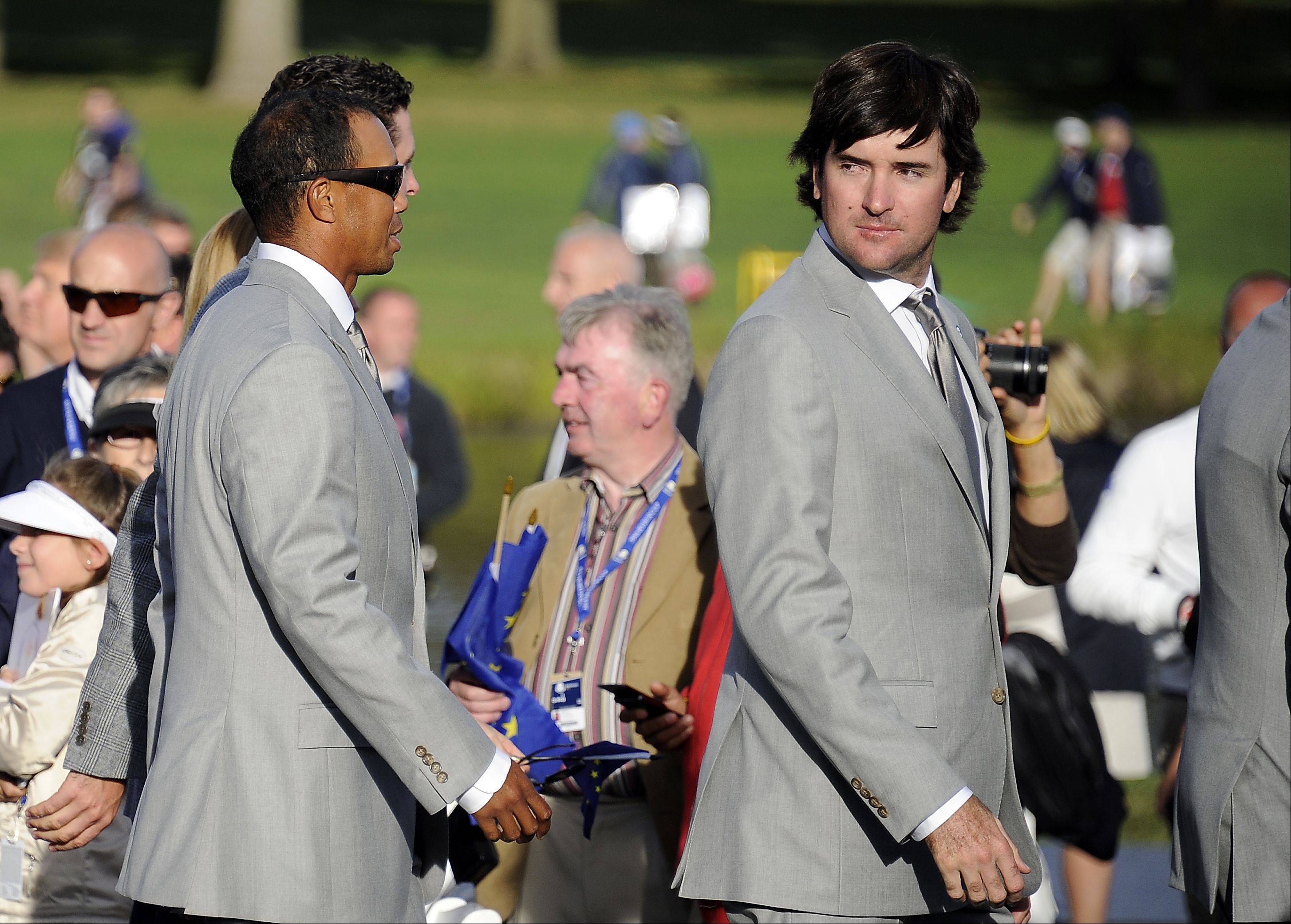 United States Bubba Watson walks the red carpet with Tiger Woods during the opening ceremonies of Ryder Cup at Medinah on Thursday.