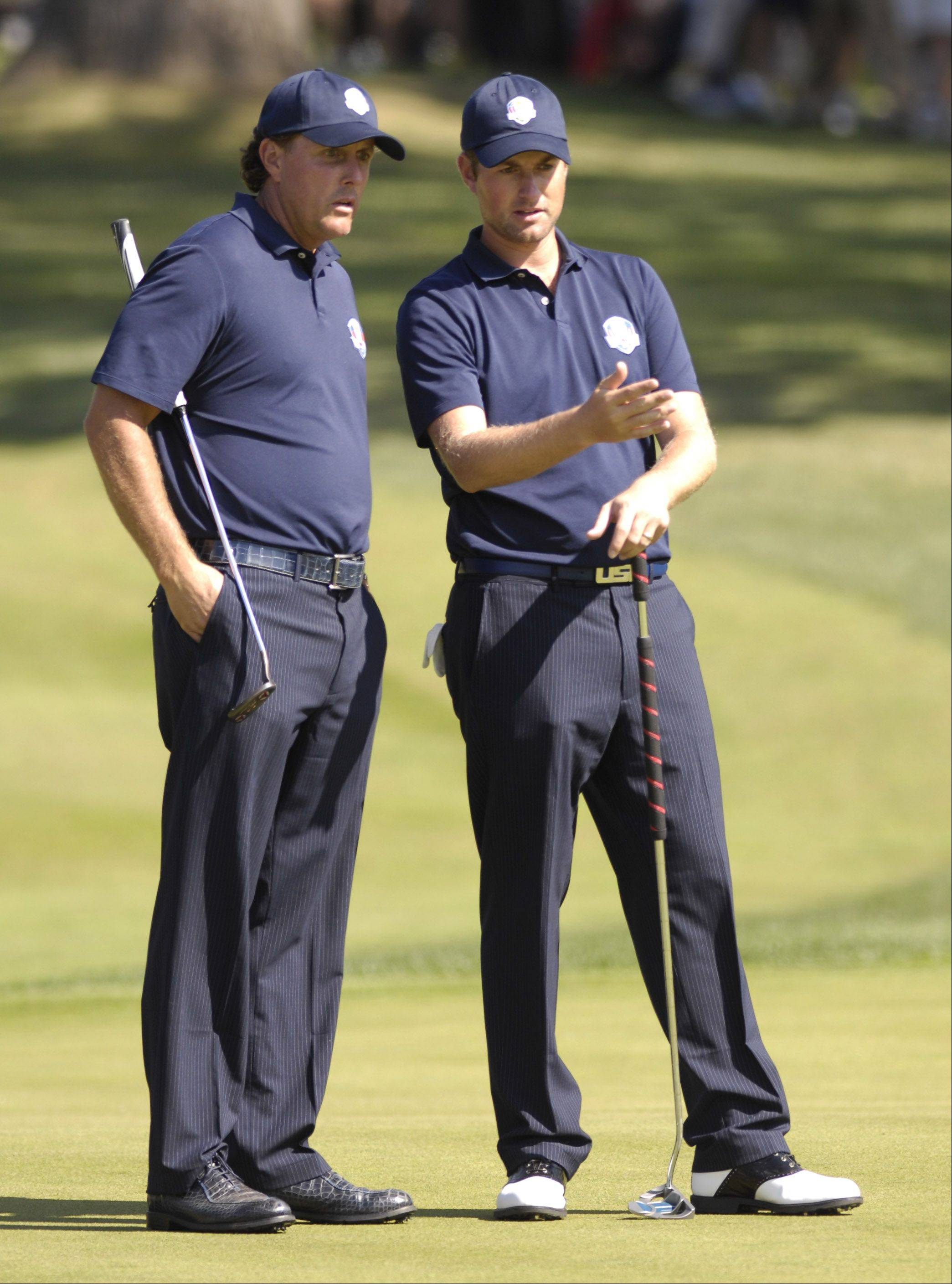 Team USA veteran Phil Mickelson, here talking with Webb Simpson at right, will set a record with his ninth Ryder Cup appearance this weekend. Having played every Ryder Cup since 1995, Mickelson owns the record for the most defeats and is 11-17-6 overall.