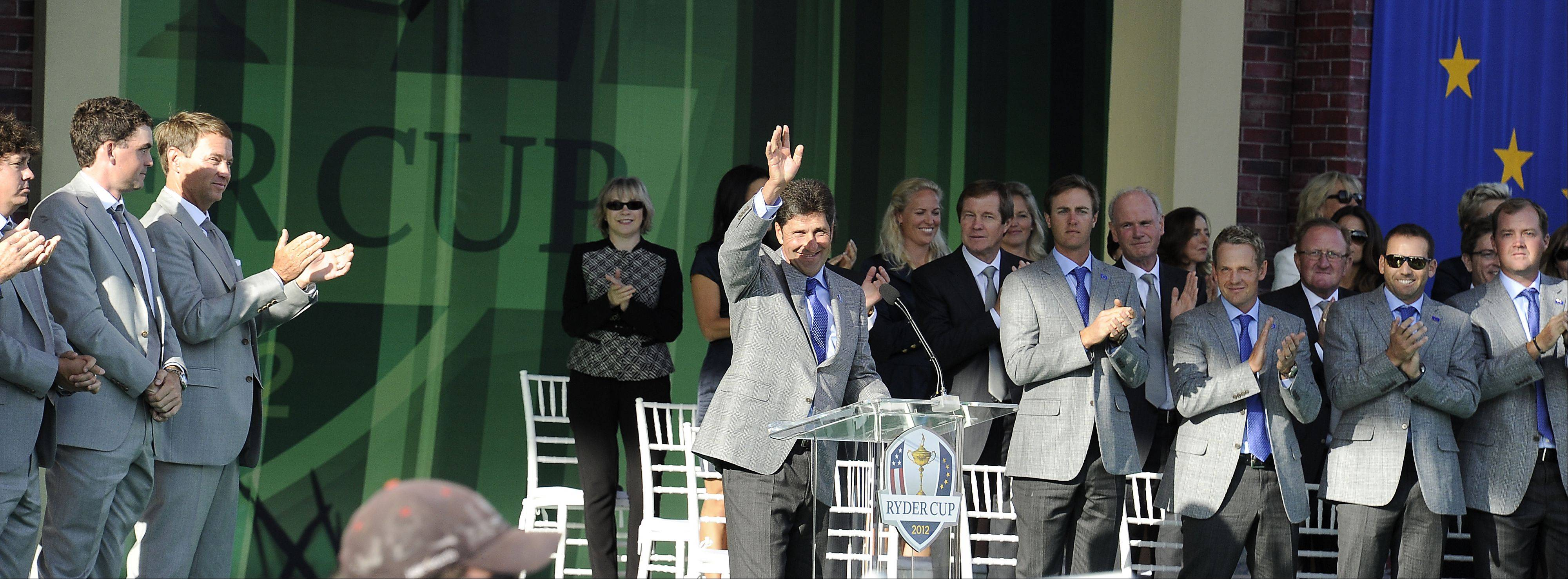 Team Europe's Jose Maria Olazabal waves to the crowd .