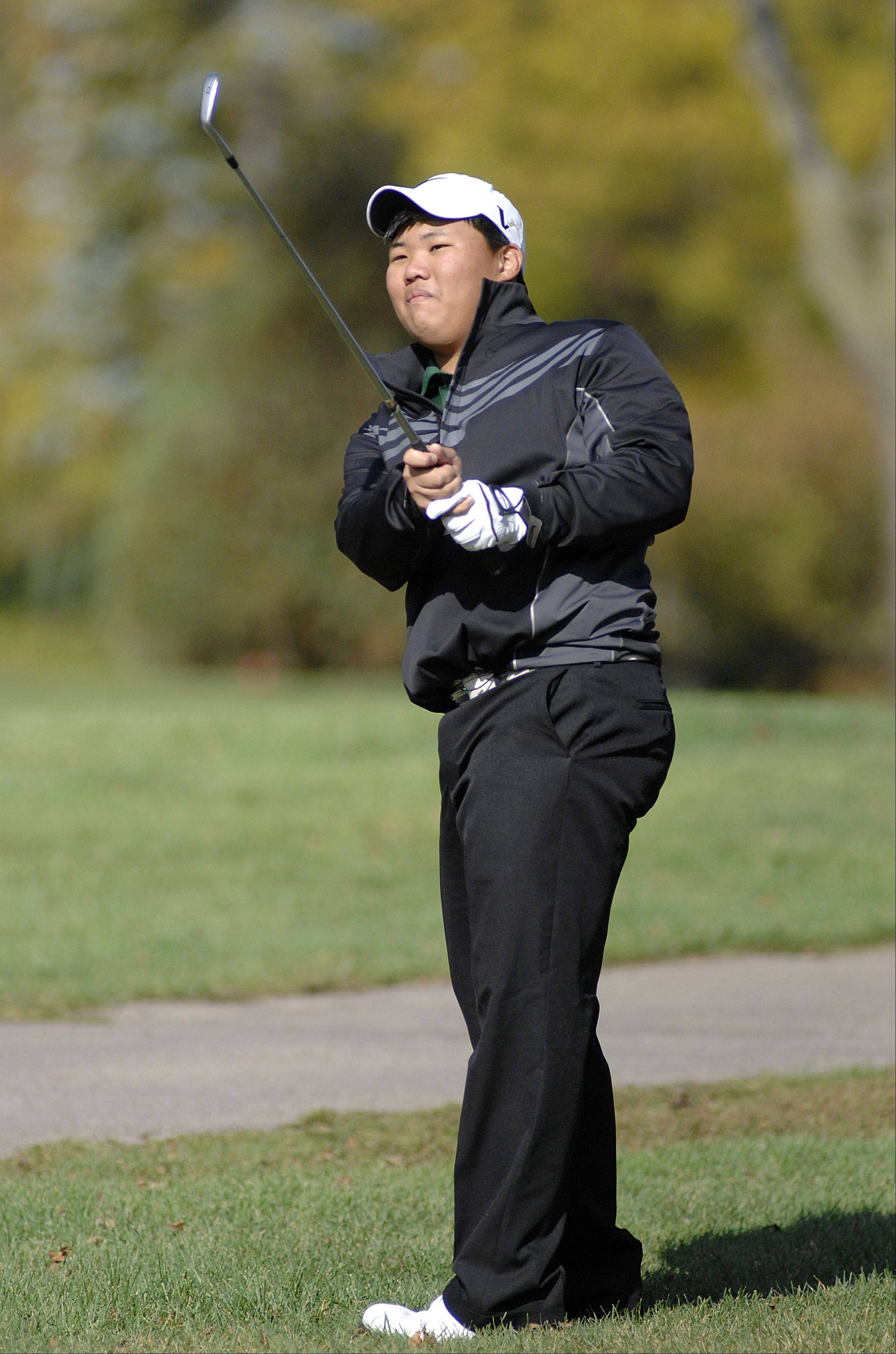 Grayslake Central's Dan Choi on the fifth hole in the Fox Valley Conference tournament at Crystal Woods Golf Course in Woodstock on Thursday, September 27.