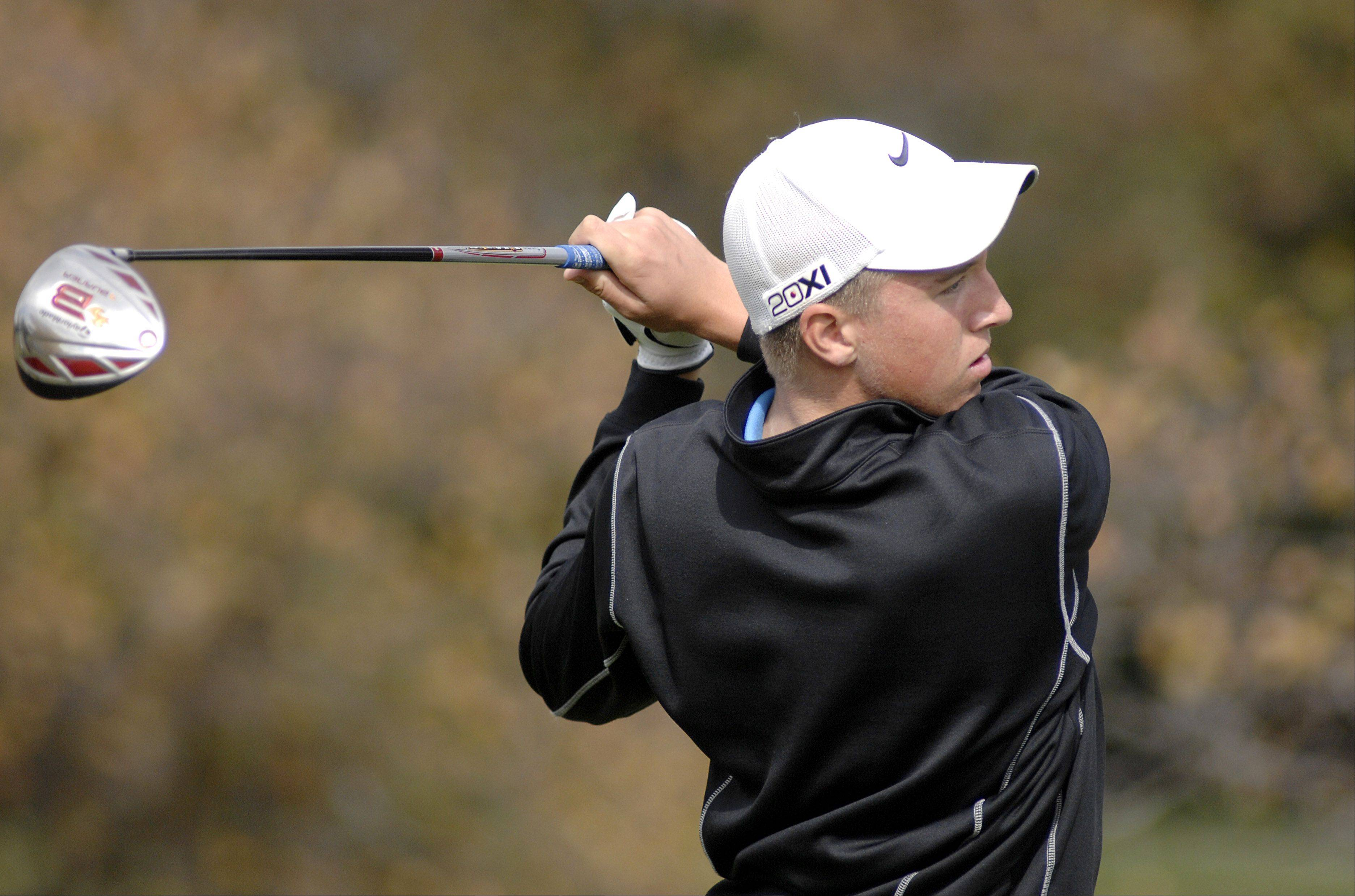 Dundee-Crown's Brenton Barrett tees off at the twelfth hole in the Fox Valley Conference tournament at Crystal Woods Golf Course in Woodstock on Thursday, September 27.