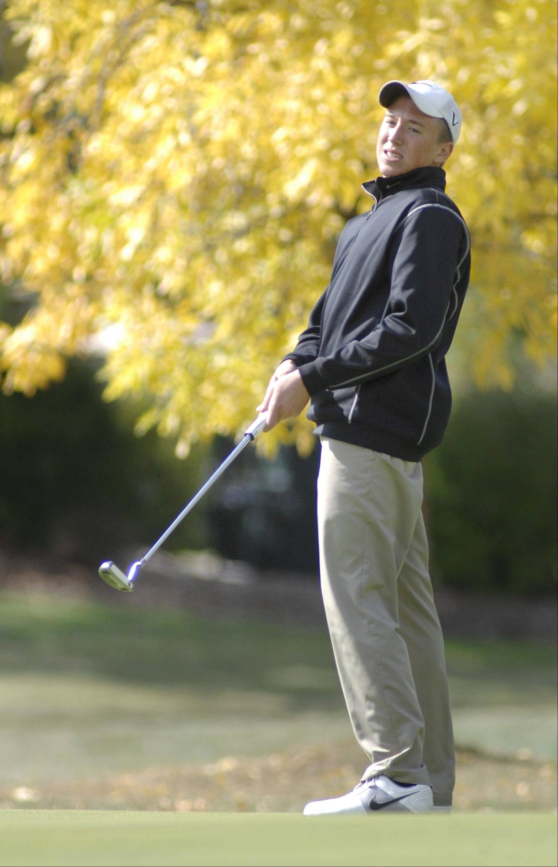 Dundee-Crown's Brenton Barrett leans back as his ball skims the hole on the eleventh green in the Fox Valley Conference tournament at Crystal Woods Golf Course in Woodstock on Thursday, September 27.