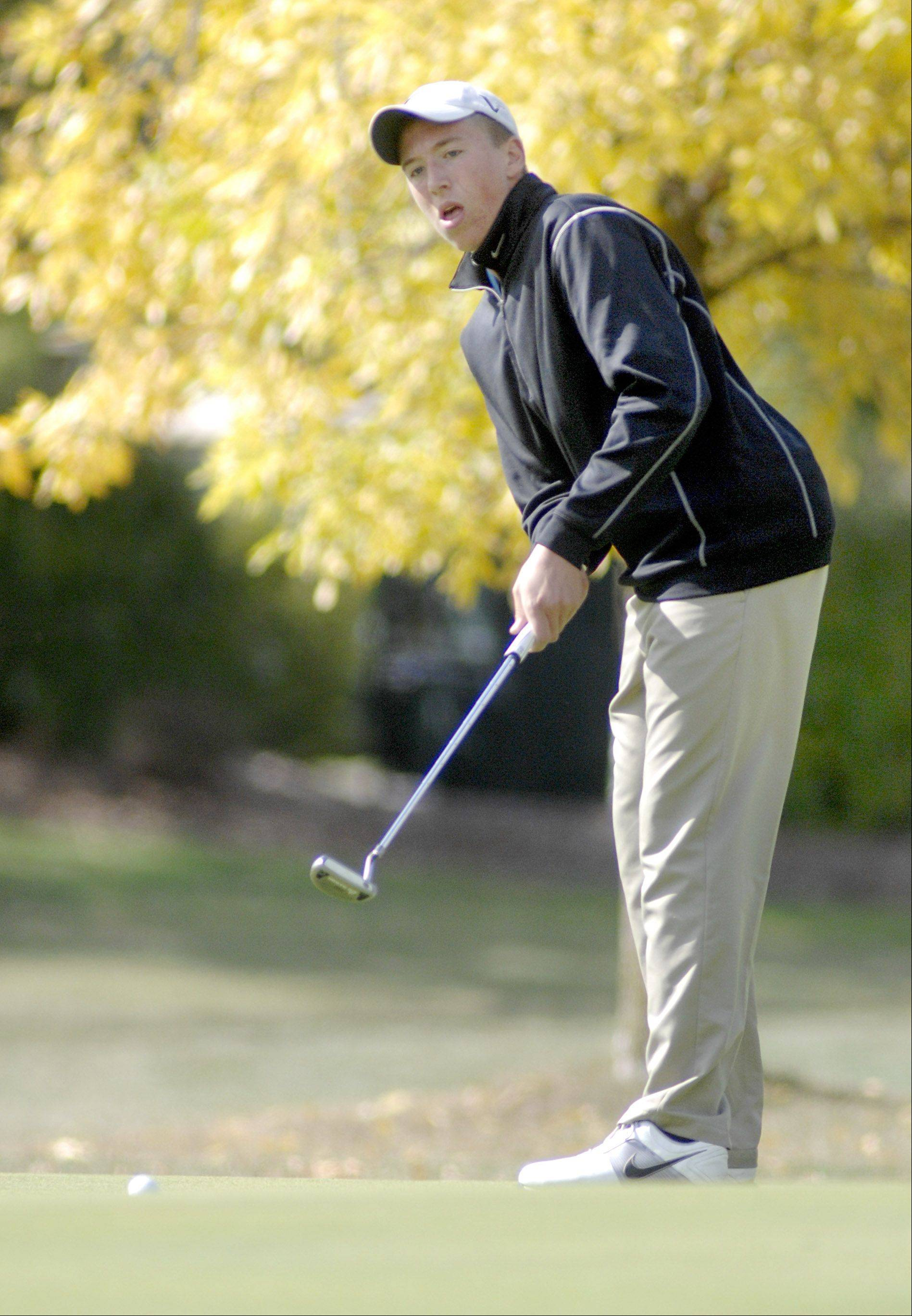 Dundee-Crown's Brenton Barrett on the eleventh hole in the Fox Valley Conference tournament at Crystal Woods Golf Course in Woodstock on Thursday, September 27.