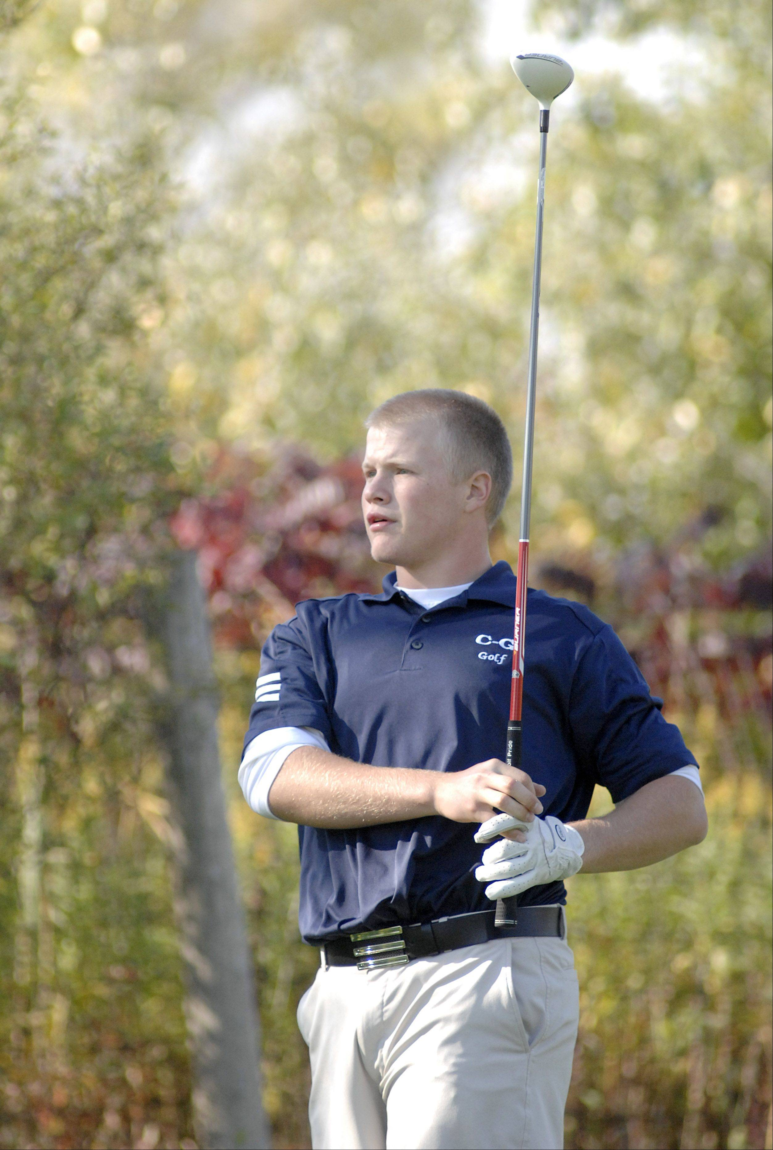 Cary Grove's Jarrett Kinney watches his ball sail from the fifth tee in the Fox Valley Conference tournament at Crystal Woods Golf Course in Woodstock on Thursday, September 27.