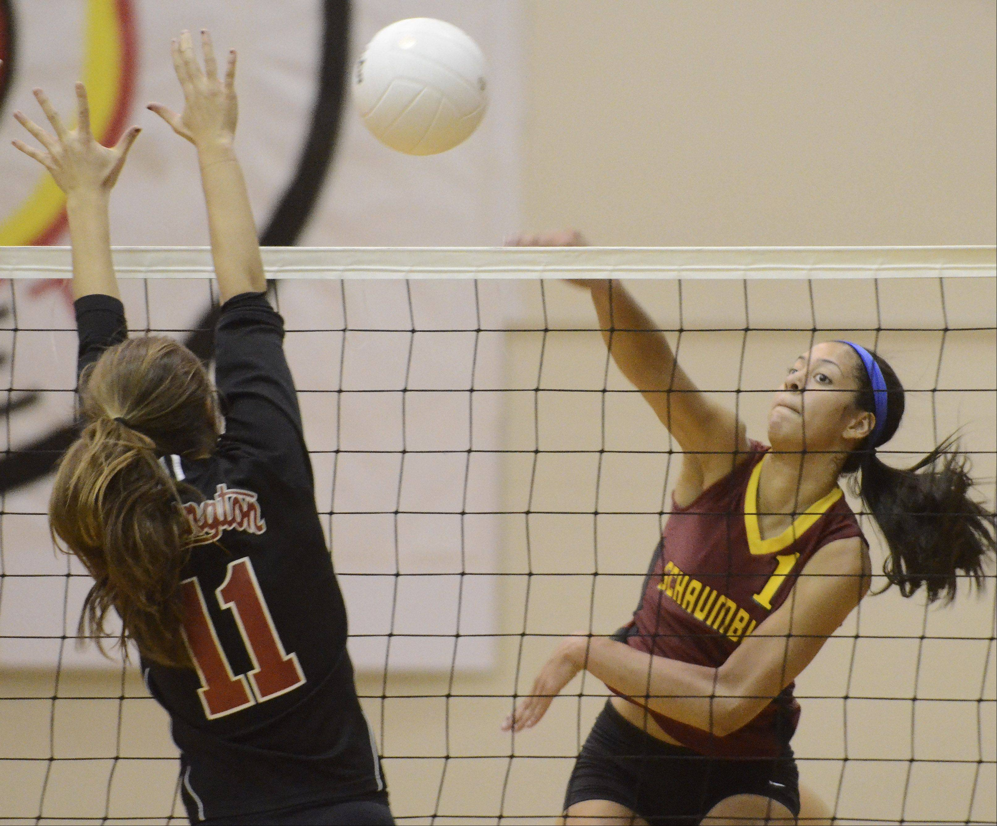 Schaumburg's Kiana Lewis, right, tries for a kill as Barrington's Christy Roney attempts to block the ball during Thursday's game.