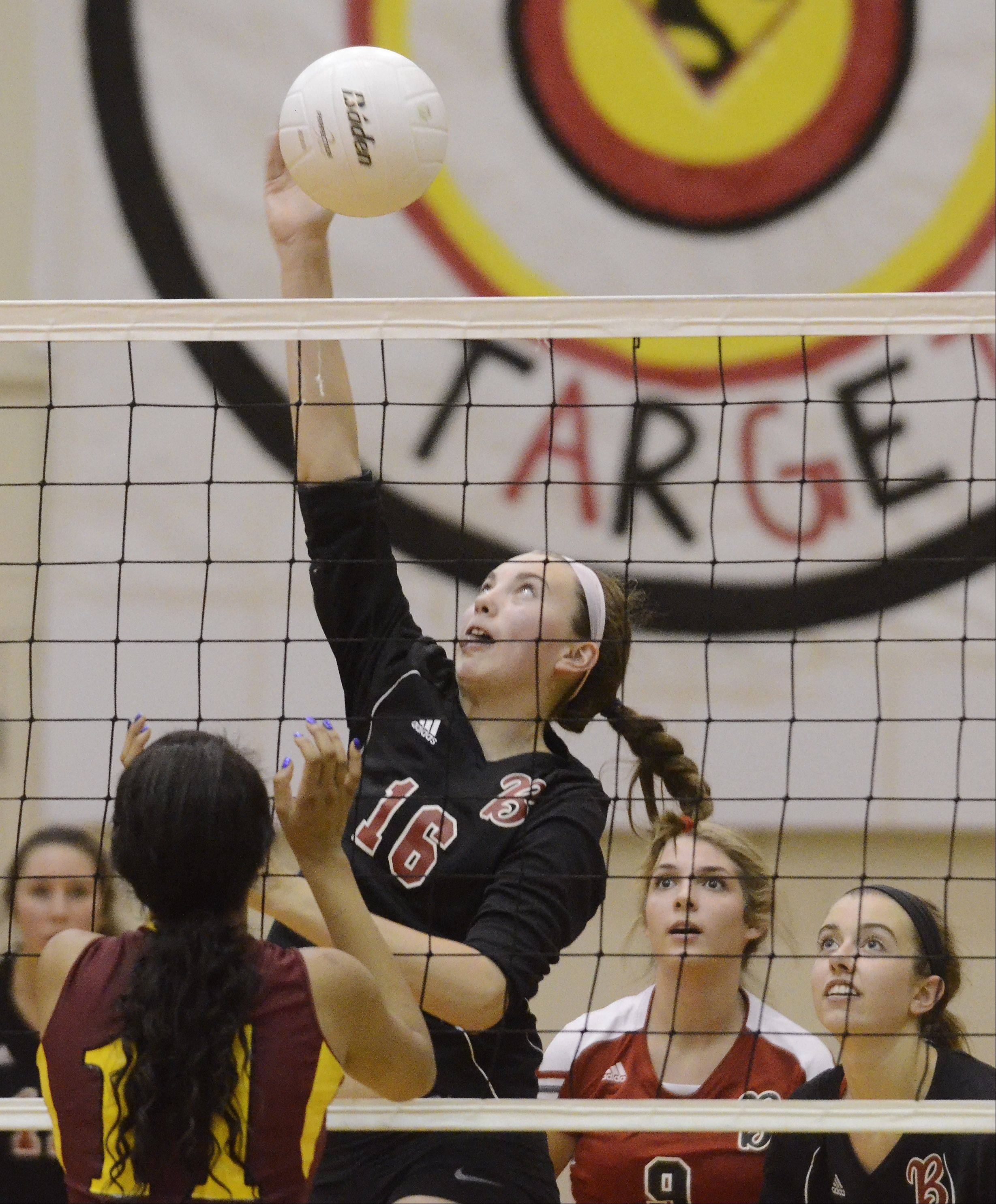 Barrington's Megan Talbot leaps for a kill as Schaumburg's Jada Blackwell stands ready at the net during Thursday's game.