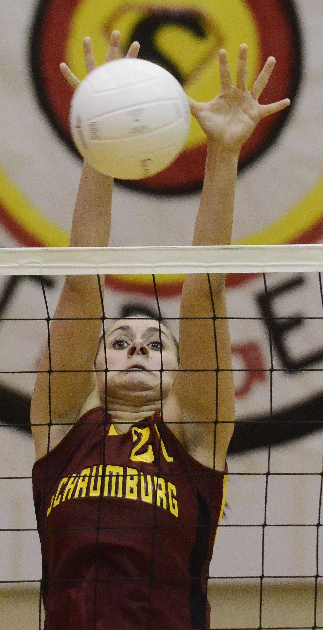 Schaumburg's Deanna Murphy leaps for a block during Thursday's game against Barrington.