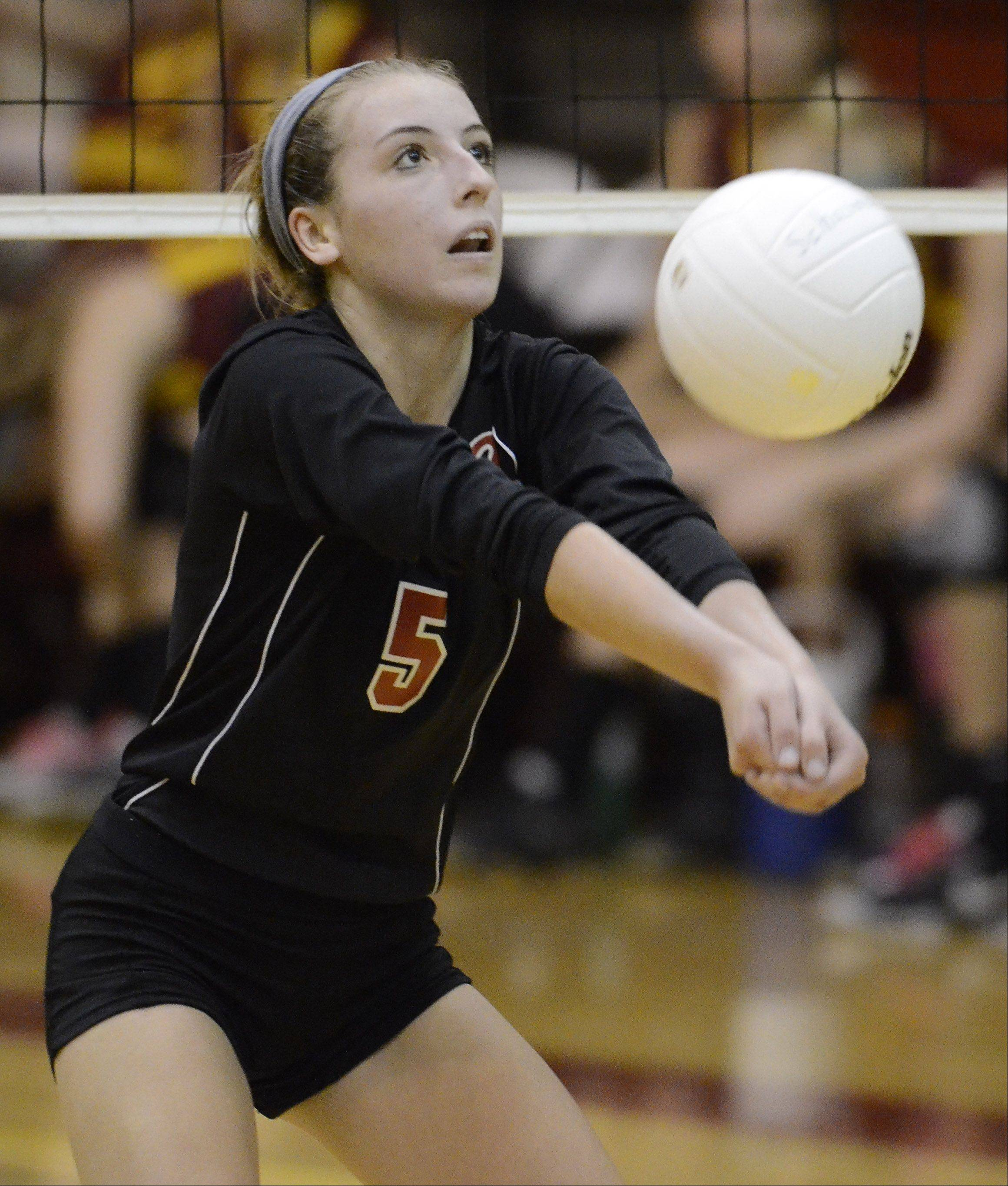Barrington's Emily Casaletto hustles for a dig during Thursday's game against Schaumburg.
