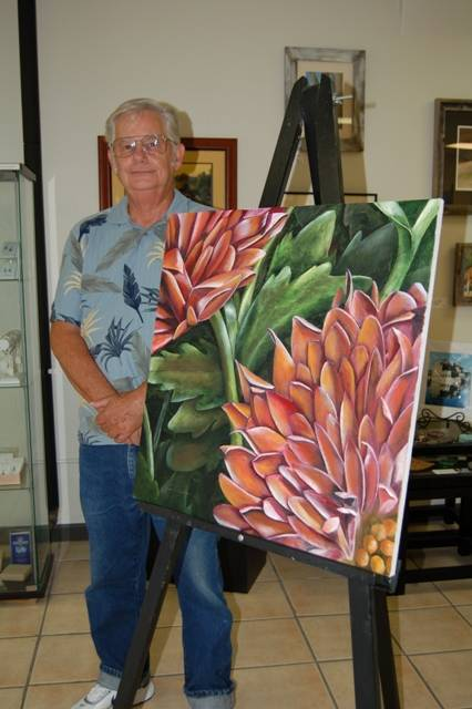 "Member artist Jim Schnaitman is pictured with ""Mums,"" an oil on canvas painting currently on display at Gallery 200, an artists' co-op and cultural initiative sponsored by the City of West Chicago and the Cultural Arts Commission."