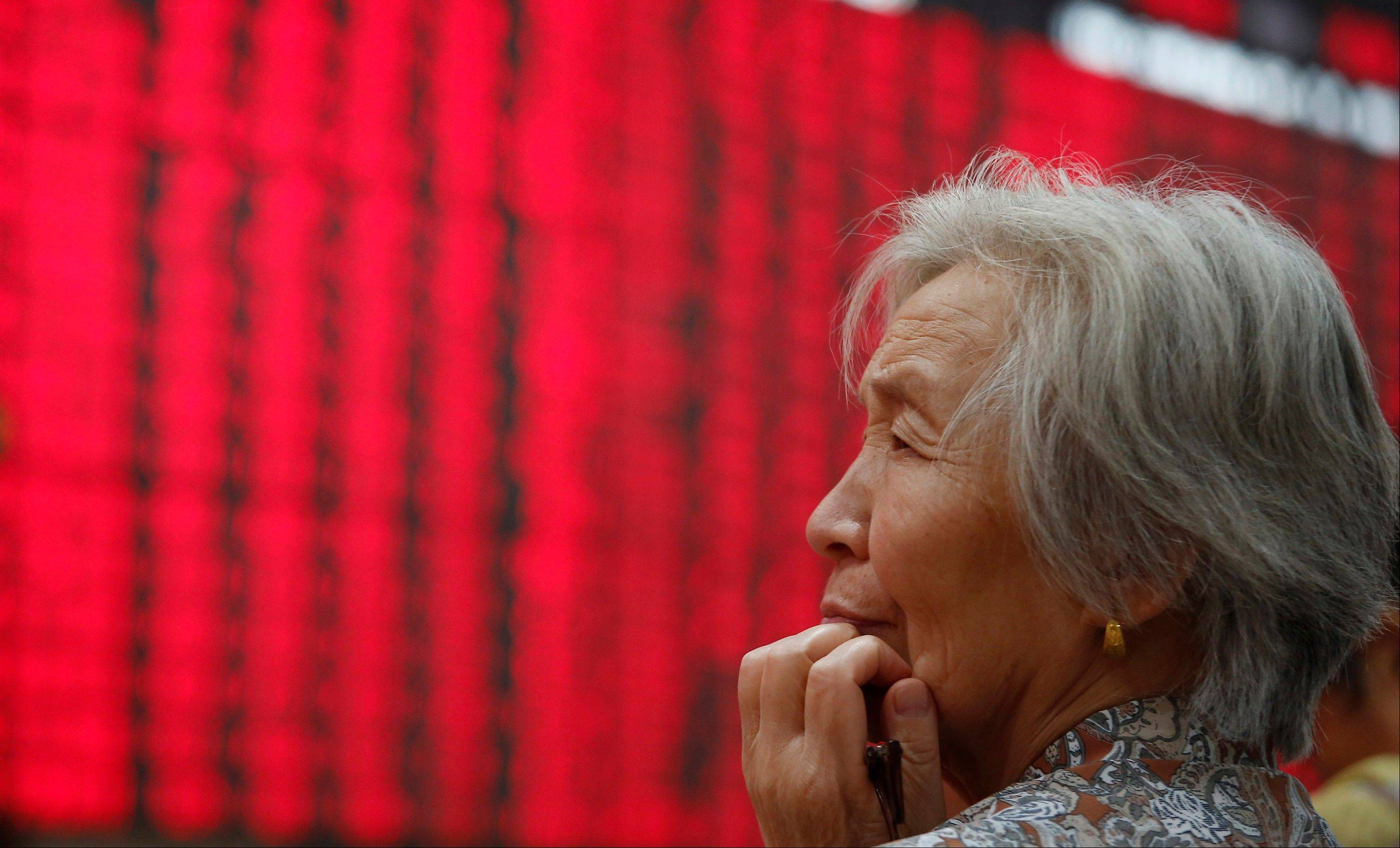 An investor looks at the stock price monitor at a private securities company .