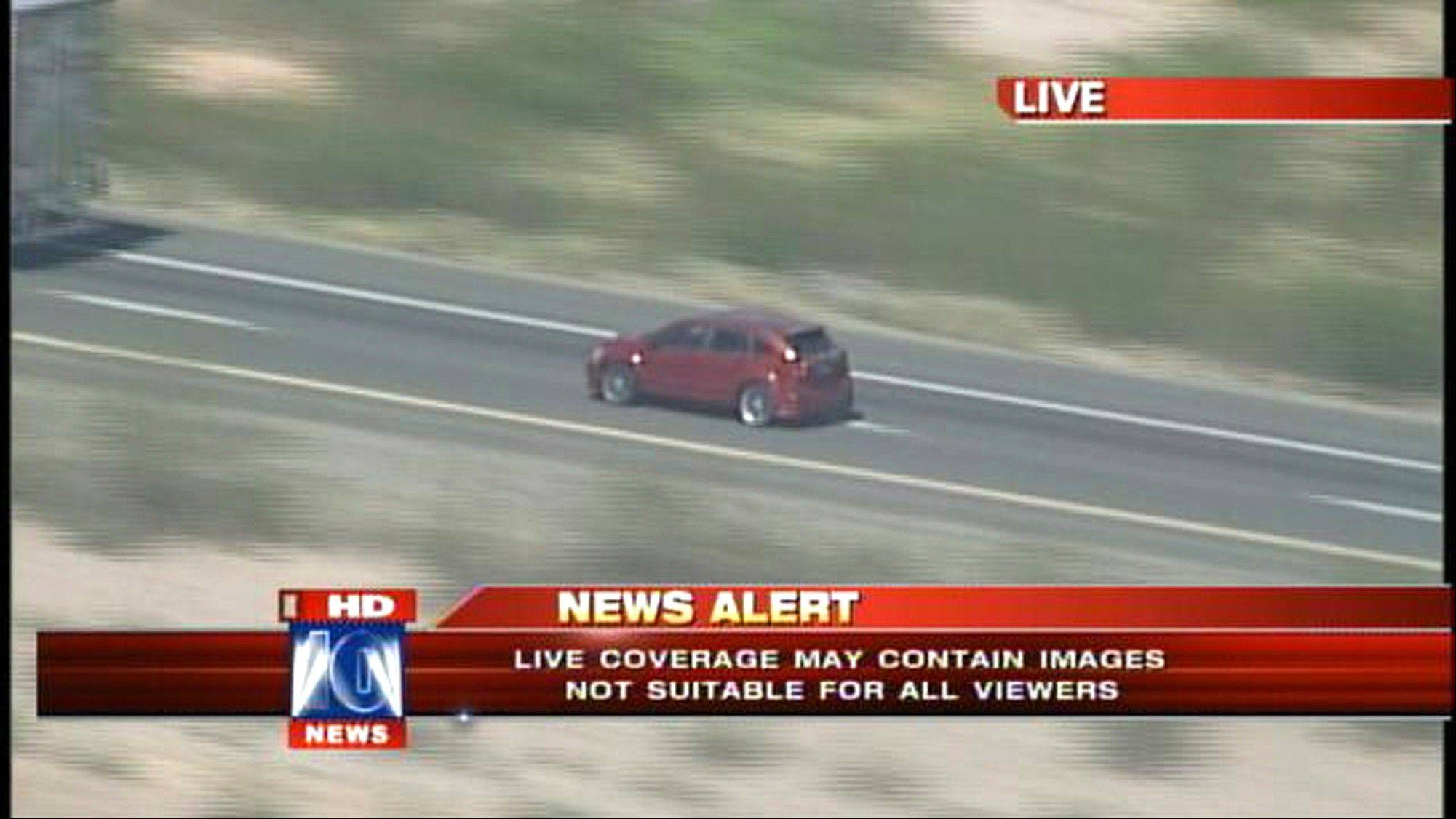 In this video grab provided by Fox 10 News, a vehicle involved in a police car chase Friday is followed on an interstate highway by a television station helicopter west of Phoenix.
