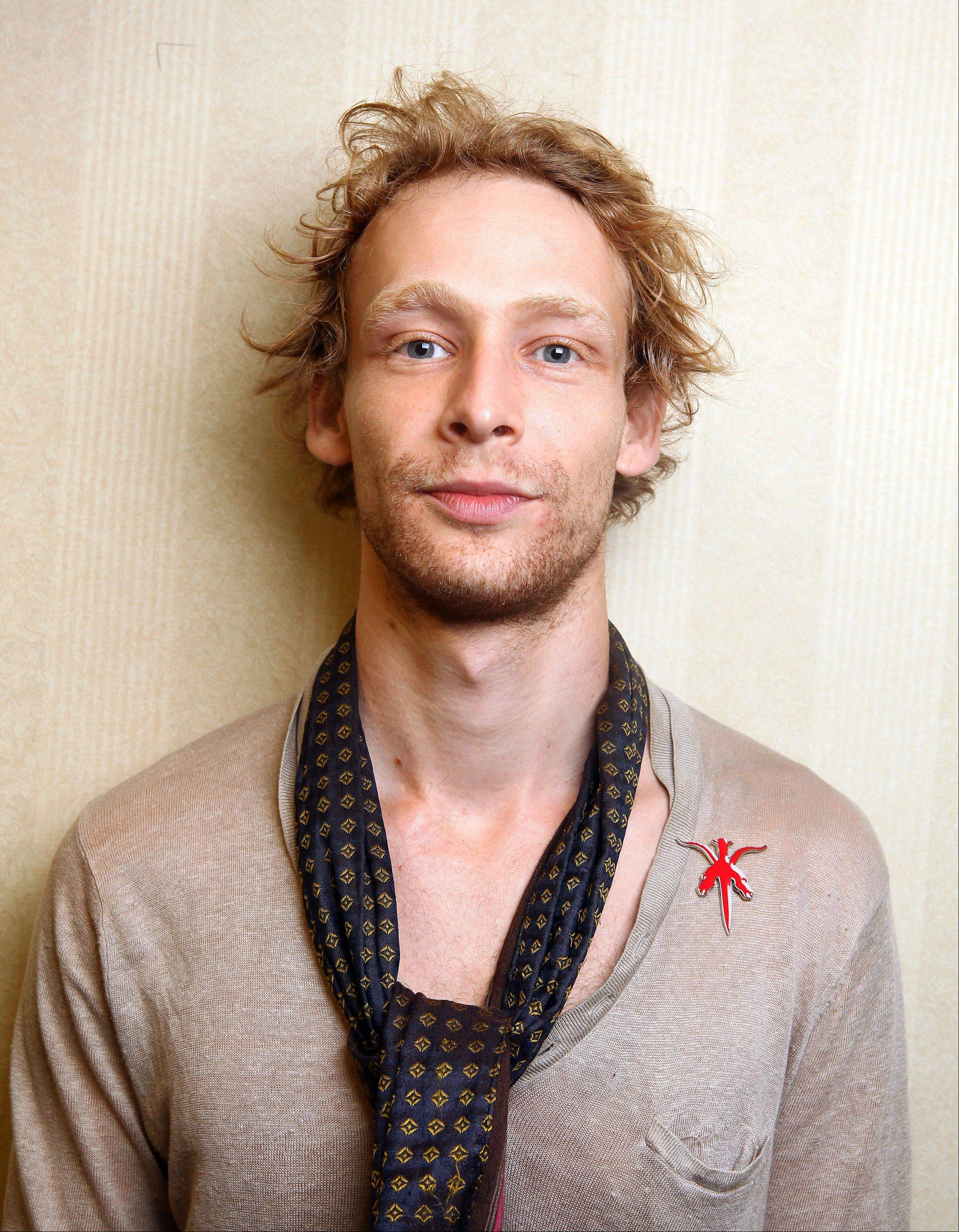 Authorities say actor Johnny Lewis fell to his death after killing an elderly Los Angeles woman. Lewis appeared in the FX television show �Sons of Anarchy,� for two seasons. The woman killed is identified as 81-year-old Catherine Davis.