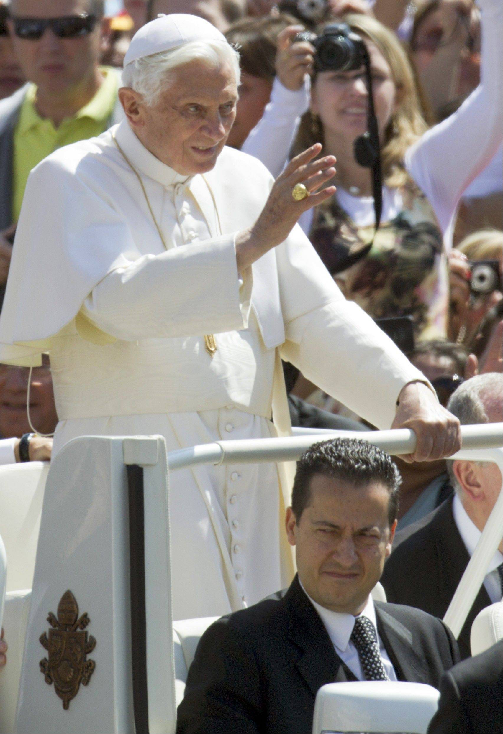 In this file photo, Pope Benedict XVI, flanked by his butler Paolo Gabiele, delivers his blessing. Pope Benedict XVI�s trusted butler, who dressed the pontiff each morning, attended his daily Mass and helped serve him his meals, stands accused of stealing the pope�s private correspondence and giving it to a journalist who wrote a blockbuster book about the secrets of one of the most secretive institutions in the world. Paolo Gabriele, a 46-year-old father of three, goes on trial Saturday Sept. 29, 2012 in the most sensational crime committed on Vatican territory since the 1998 double murder of the Swiss Guard commander and his wife. That case never came to trial because the suspect killed himself.