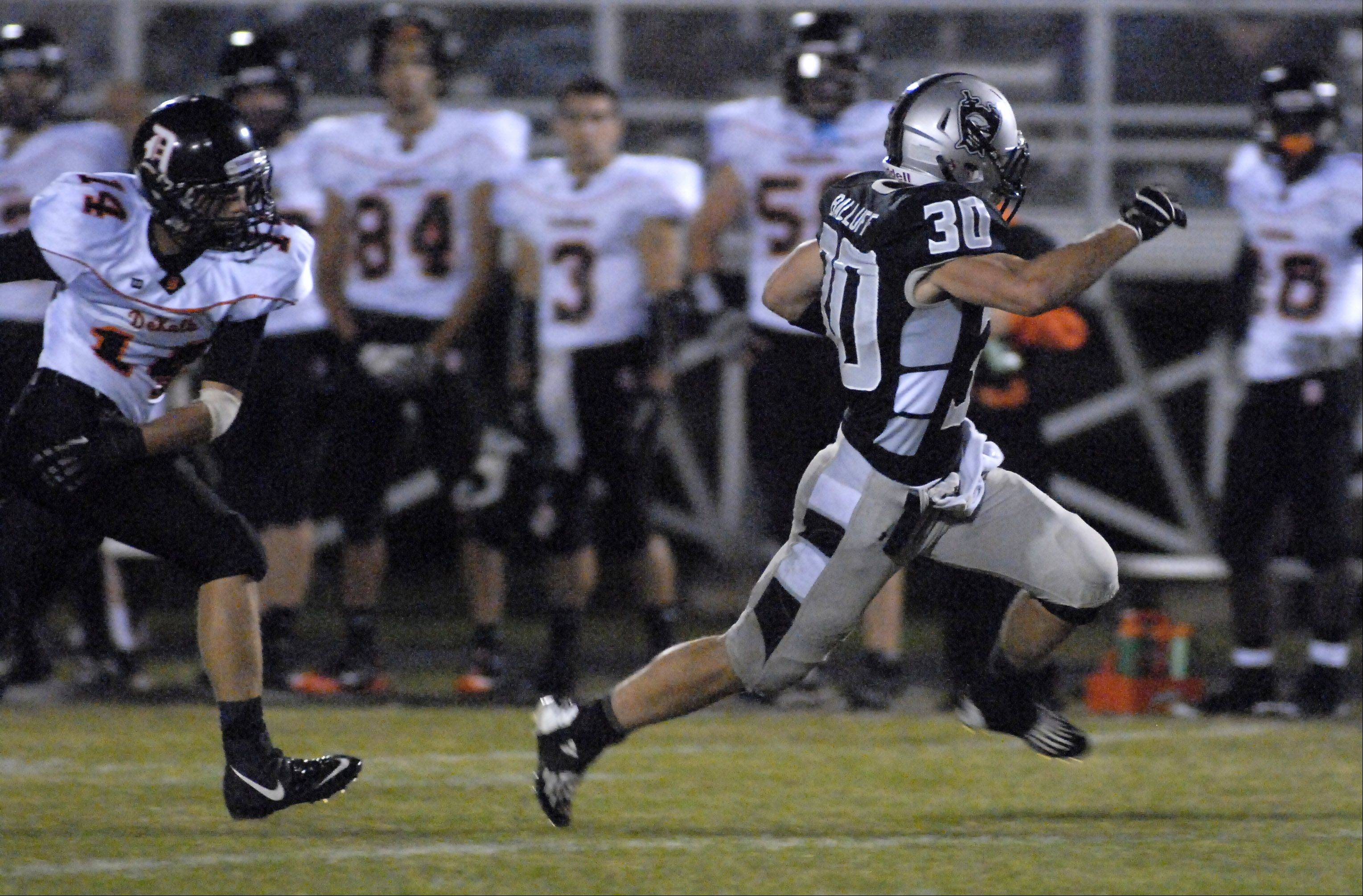 Laura Stoecker/lstoecker@dailyherald.com Kaneland's Jesse Balluff shakes off DeKalb's Jake Young in the first quarter as he makes his way to the end zone on Friday, September 28.