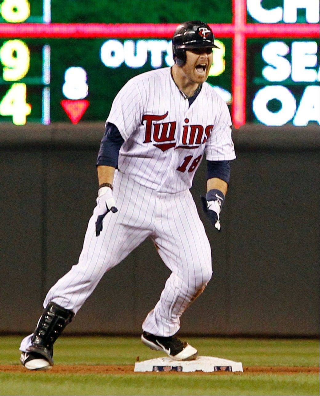 Twins designated hitter Ryan Doumit gives a shout after hitting a two-run double against Detroit relief pitcher Brayan Villarreal during the eighth inning Friday in Minneapolis.