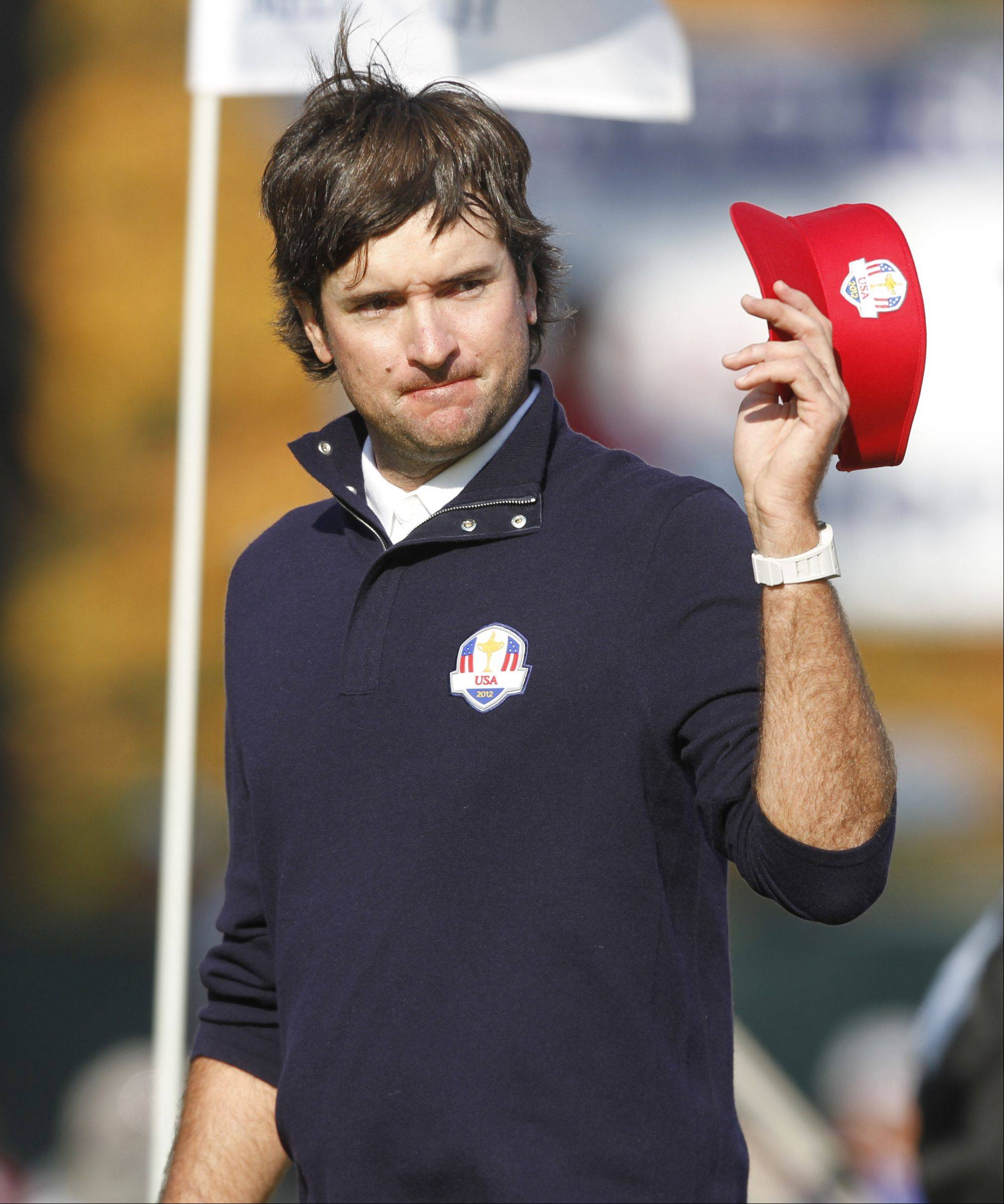 Bubba Watson waives to the Ryder Cup crowd on the 14th hole after winning his afternoon match Friday at Medinah Country Club.