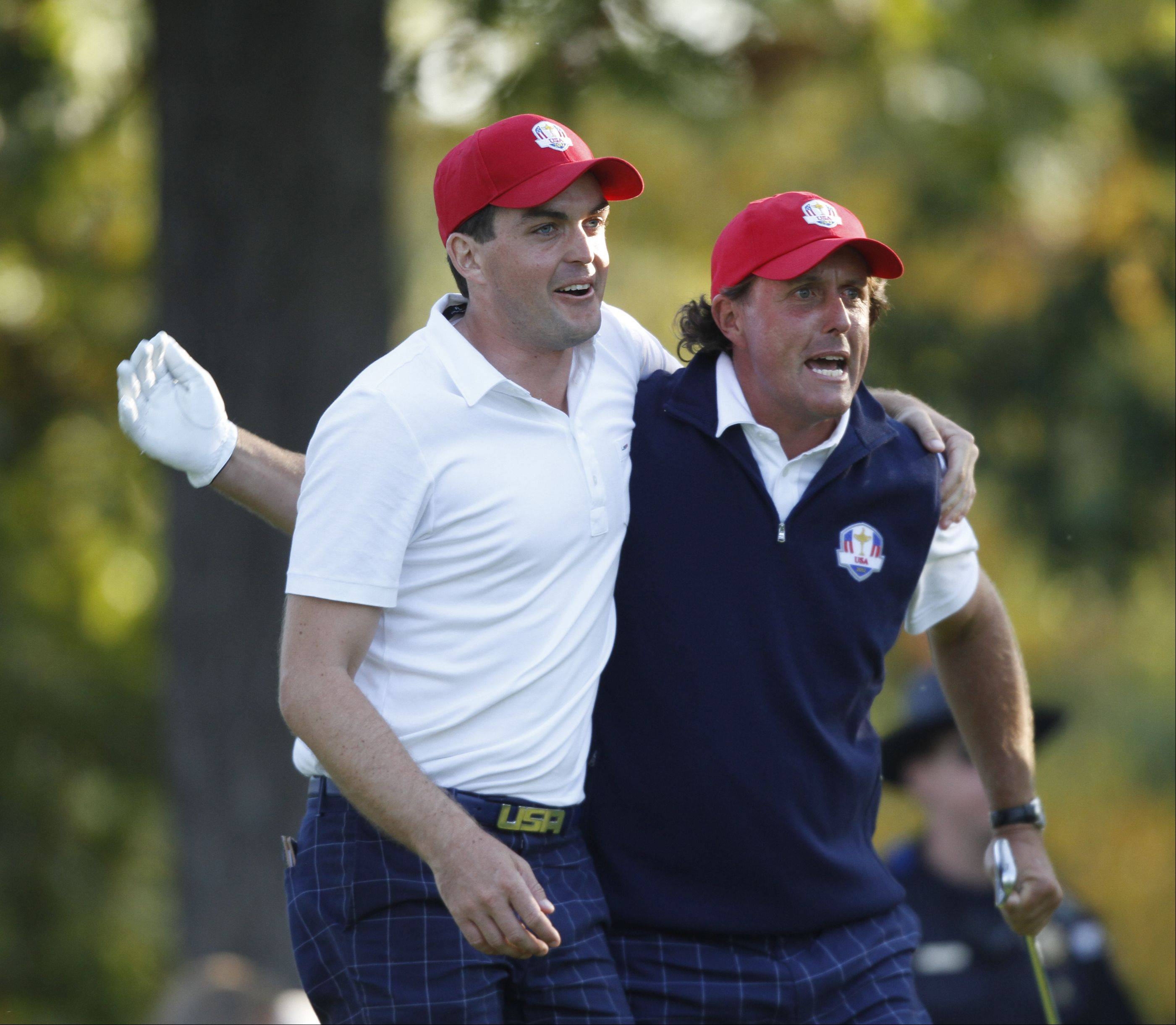 Keegan Bradley, left, and Phil Mickelson congratulate each other after Mickelson�s drive on the 17th hole land just feet from the cup. That drive clinched the match for their round and gave the US team another point Friday afternoon at the 2012 Ryder Cup at Medinah Country Club.