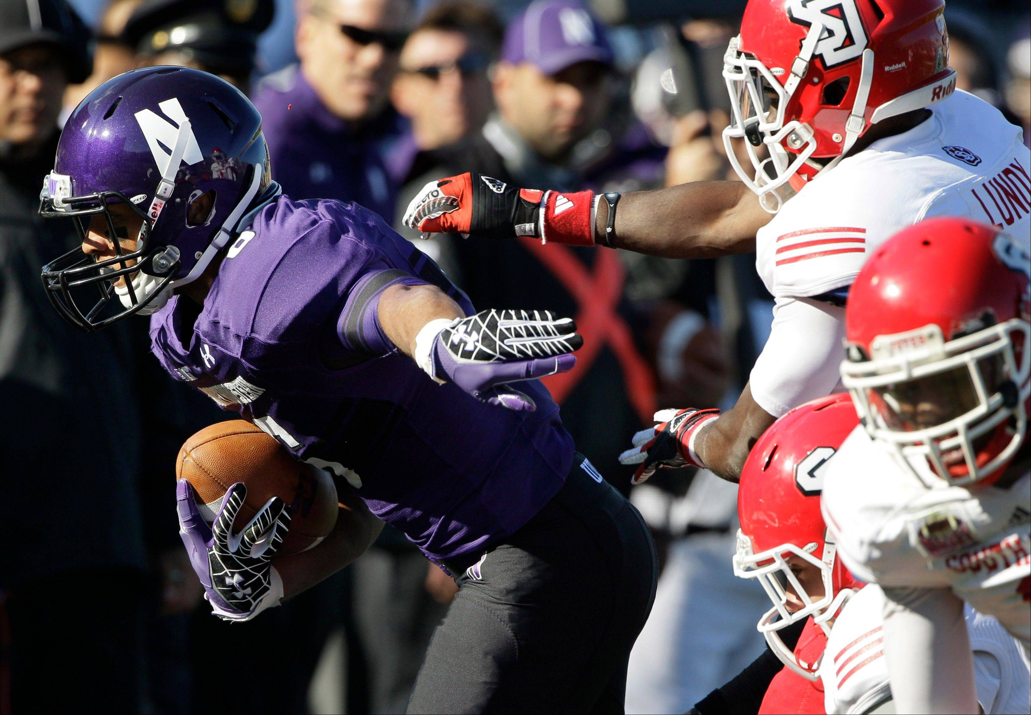 Northwestern wide receiver Tony Jones runs past South Dakota defensive back Chris Lundy during last Saturday�s game in Evanston.