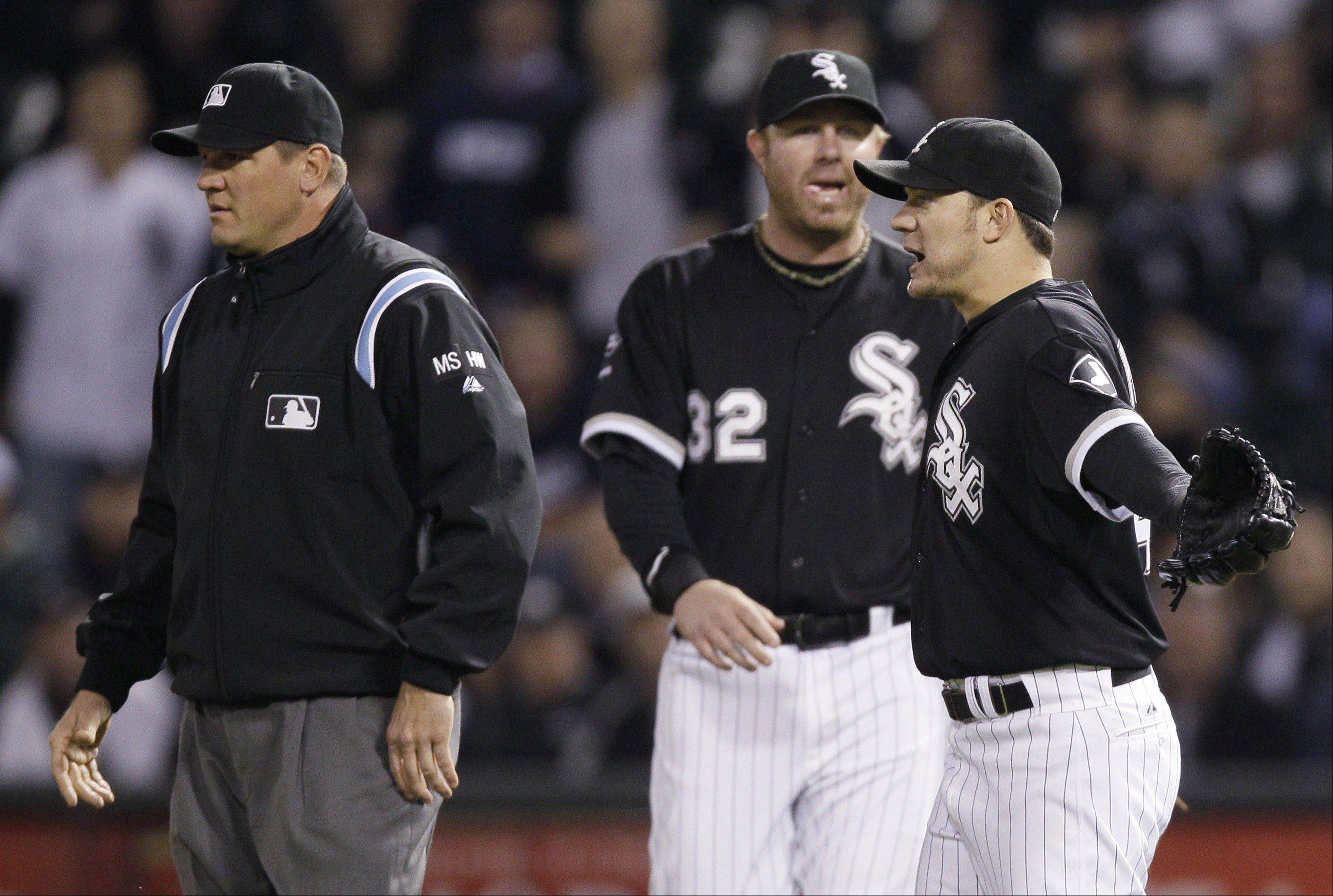 White Sox pitcher Jake Peavy reacts Thursday after being called for a balk against the Tampa Bay Rays during the second inning at U.S. Cellular Field. At left is first base umpire Chad Fairchild, who did not make the balk call. At center is Adam Dunn.
