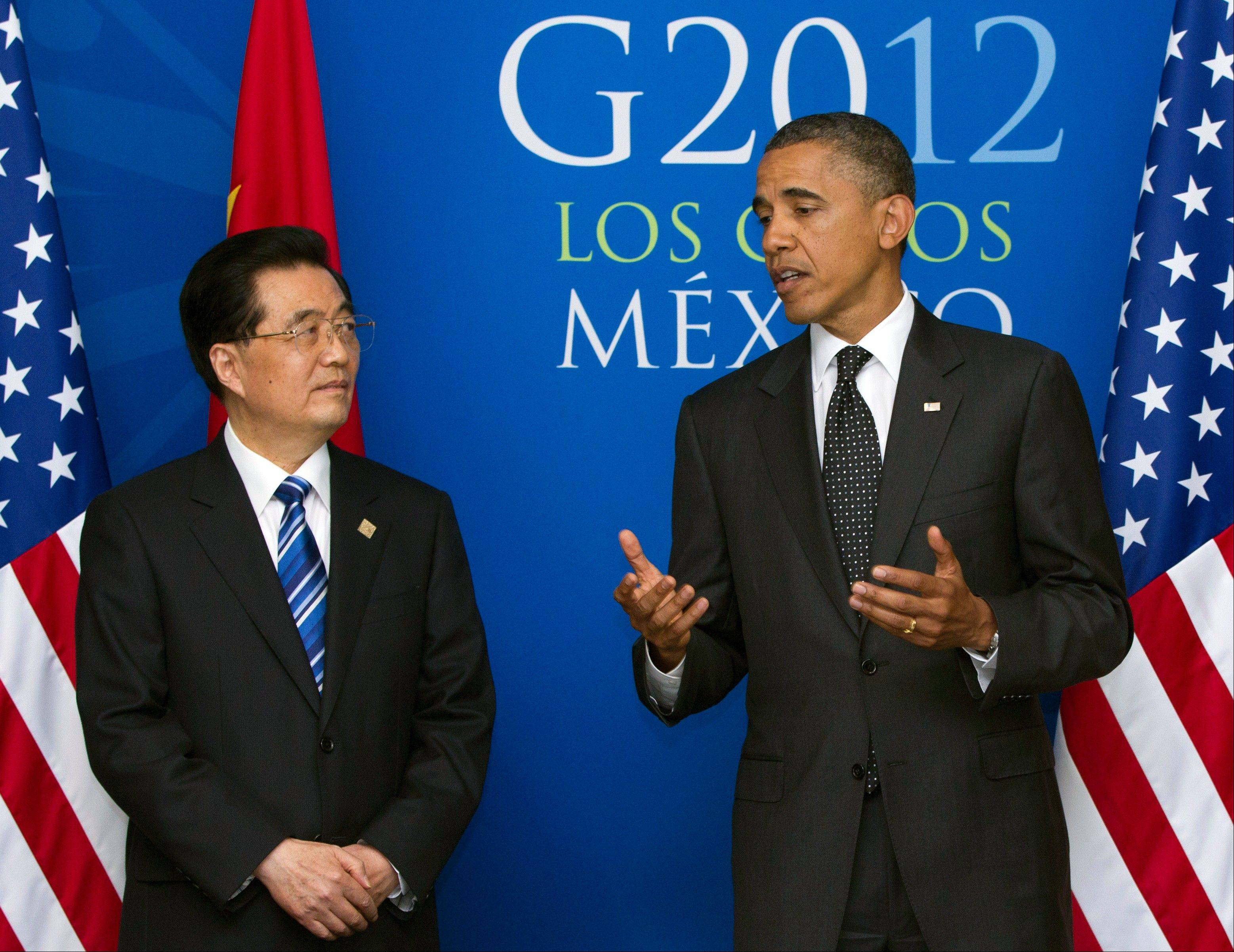 Associated Press/June 19, 2012President Barack Obama speaks as he attends a bilateral meeting with Chinaís President Hu Jintao during the G20 Summit, in Los Cabos, Mexico.