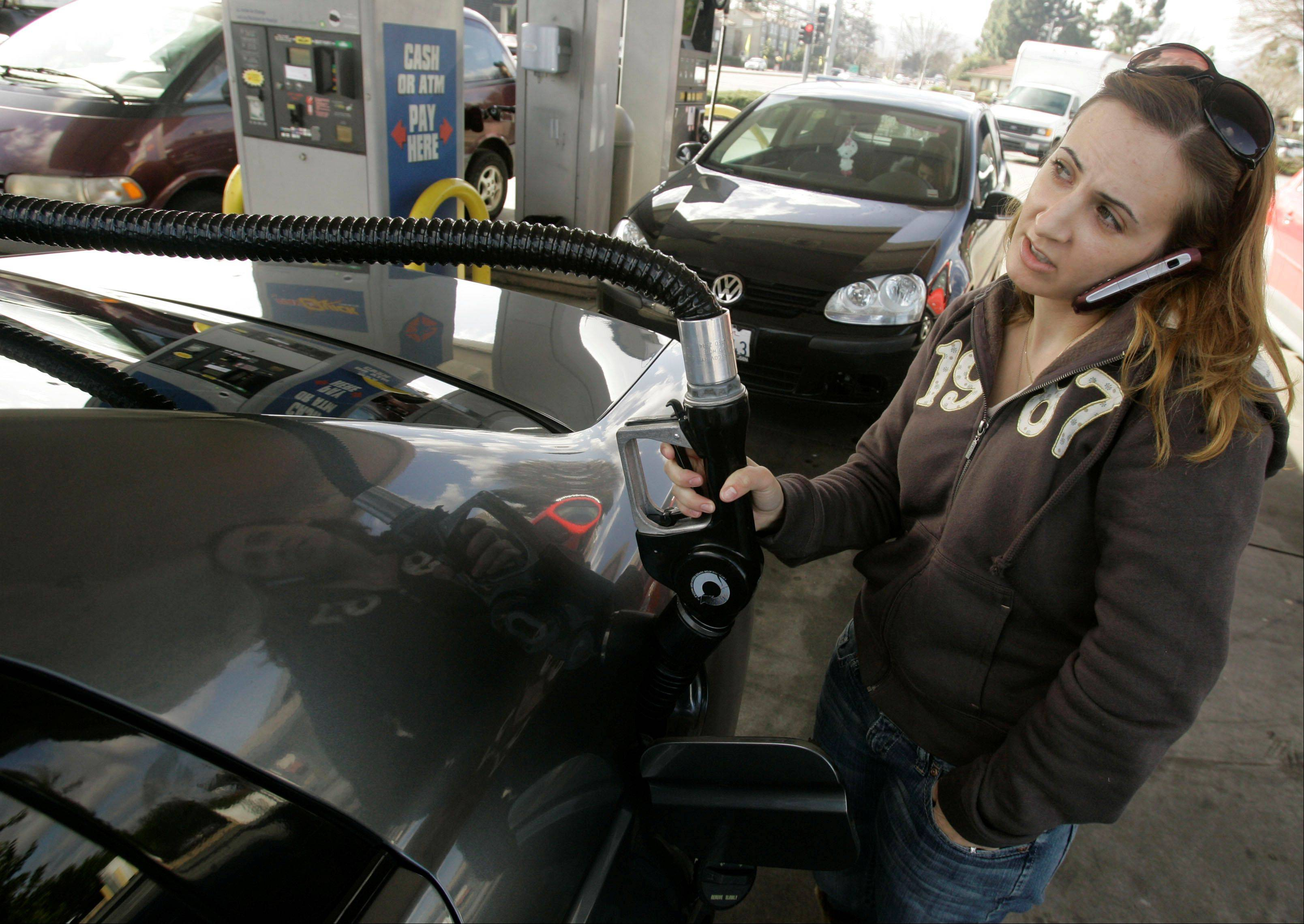 Americans spent at the fastest pace in six months in August but much of that increase went to pay their higher gas bills, the Commerce Department announced Friday, Sept. 28, 2012.