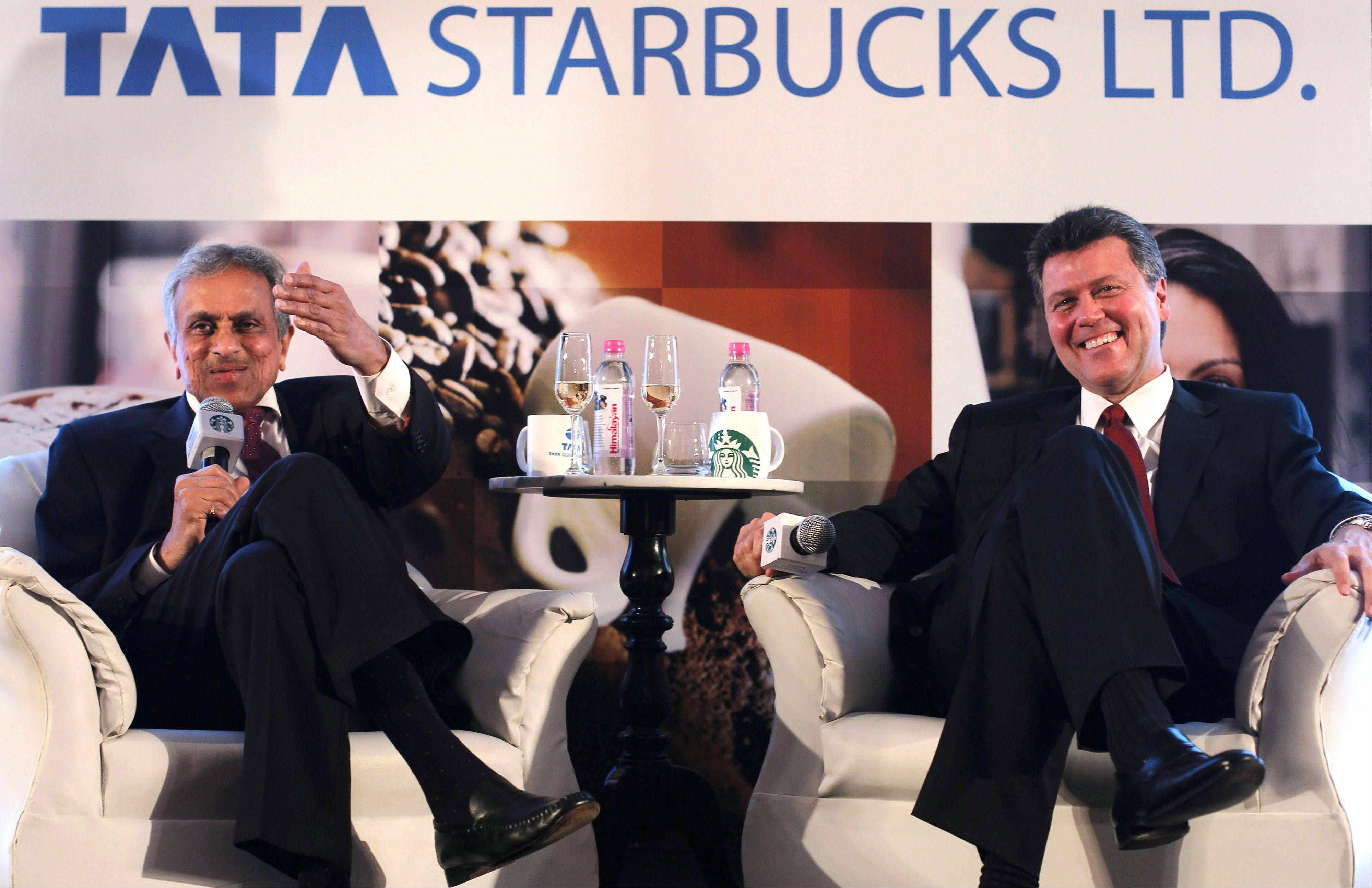 R.K. Krishankumar, vice chairman of Tata Global Beverages, left, along with John Culver, president of Starbuck China and Asia Pacific, meet the media in Mumbai, India.