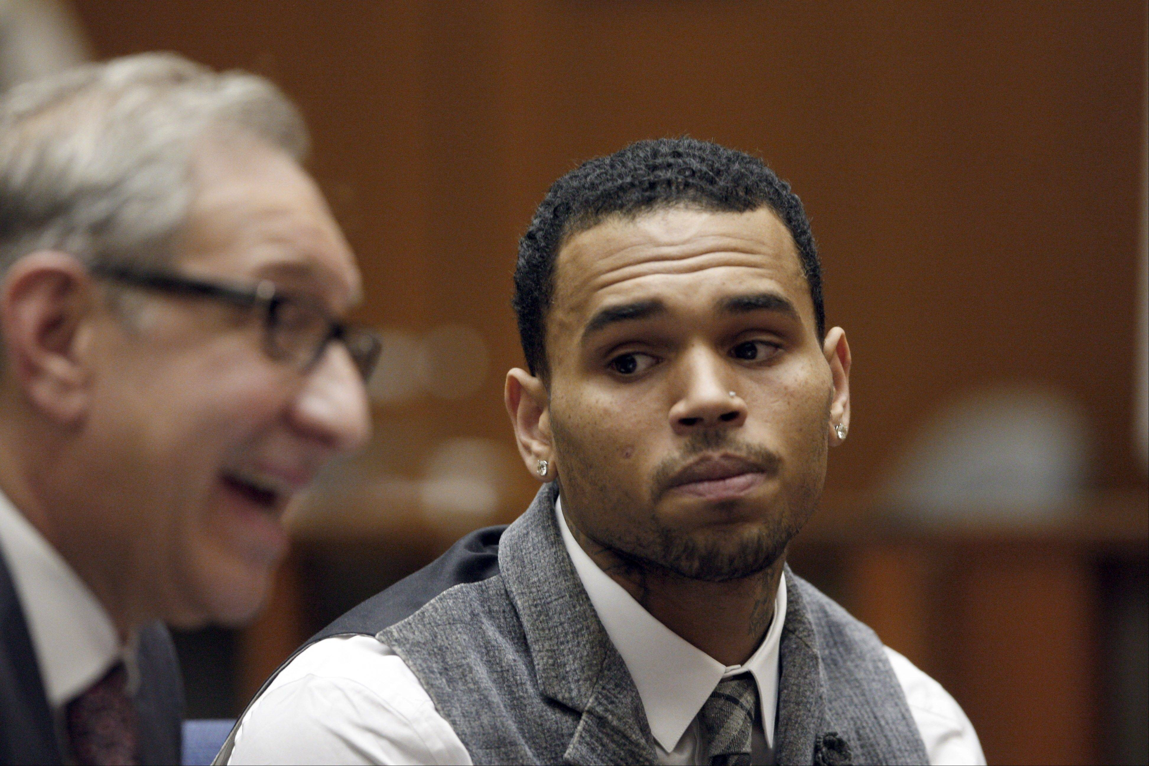 Judge Patricia Schnegg has ordered a further review of Chris Brown's community service and travel to determine whether he has violated the terms of his probation for the 2009 beating of then-girlfriend Rihanna.