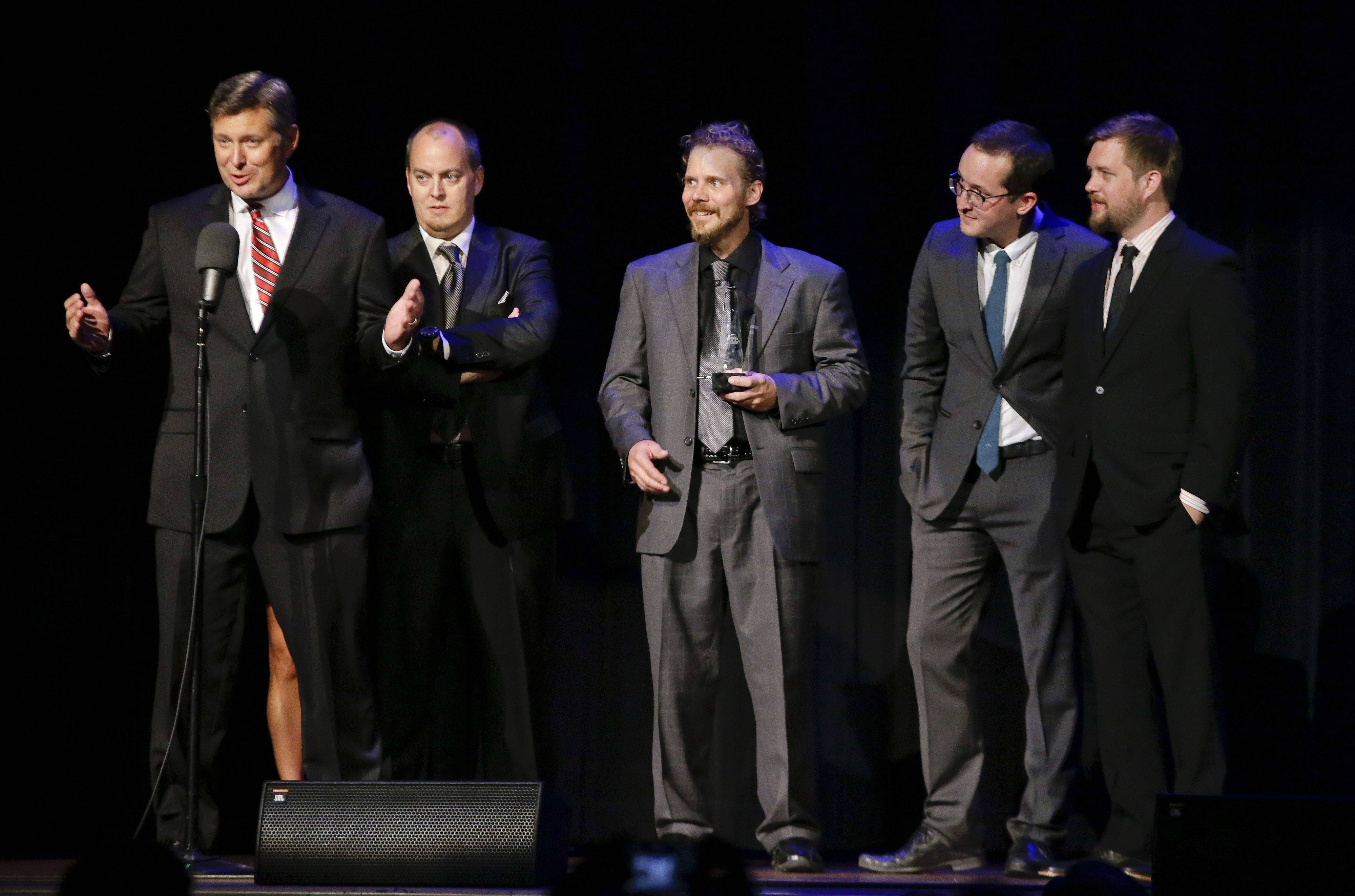 The Gibson Brothers accept the entertainer of the year award at the International Bluegrass Music Association Awards show on Thursday in Nashville.