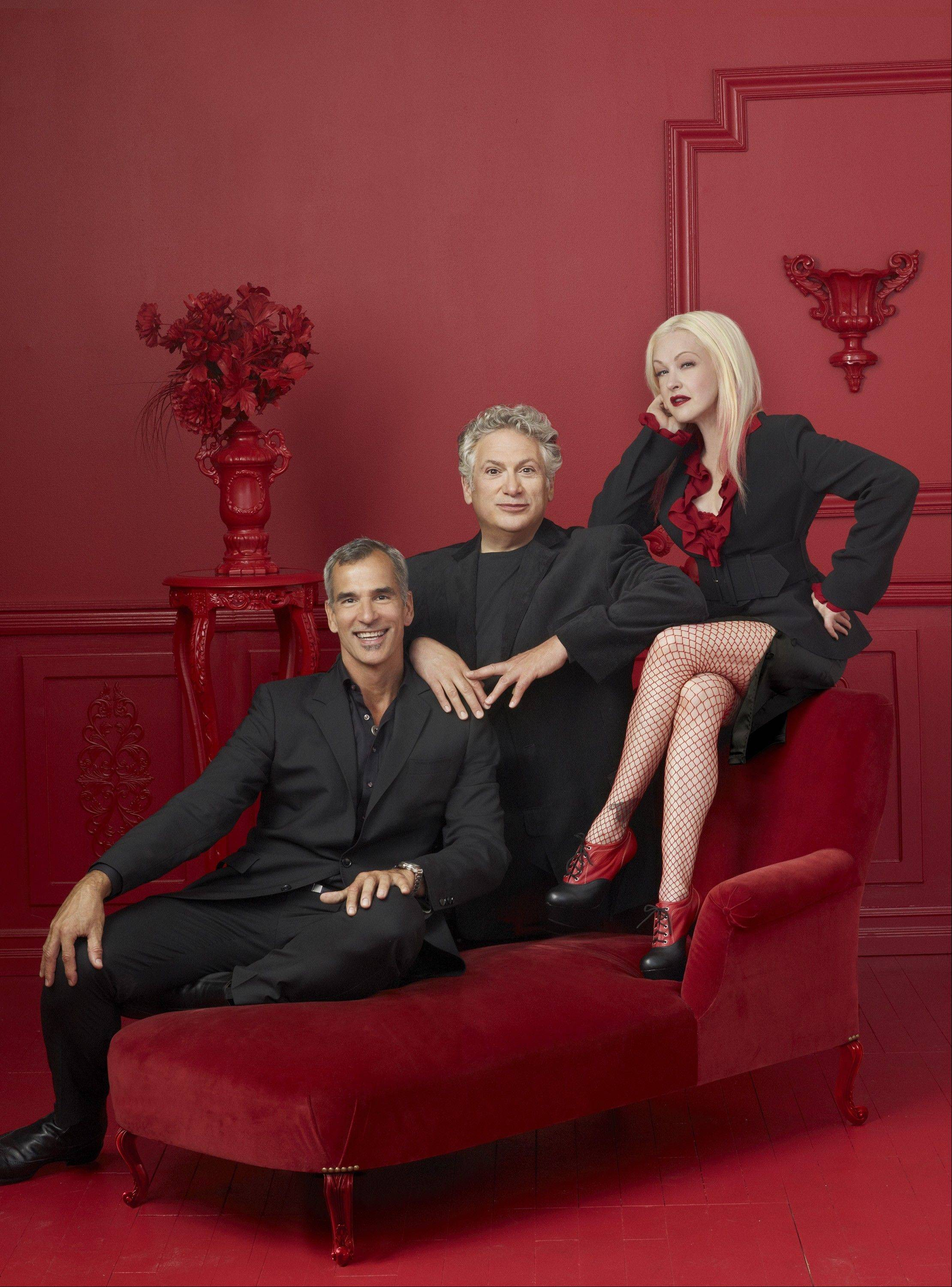 "Director/choreographer Jerry Mitchell, from left, book writer Harvey Fierstein and composer/lyricist Cyndi Lauper are the creative team for the Broadway-bound musical ""Kinky Boots,"" which has its world premiere at Chicago's Bank of America Theatre Tuesday, Oct. 2, through Sunday, Nov. 4."