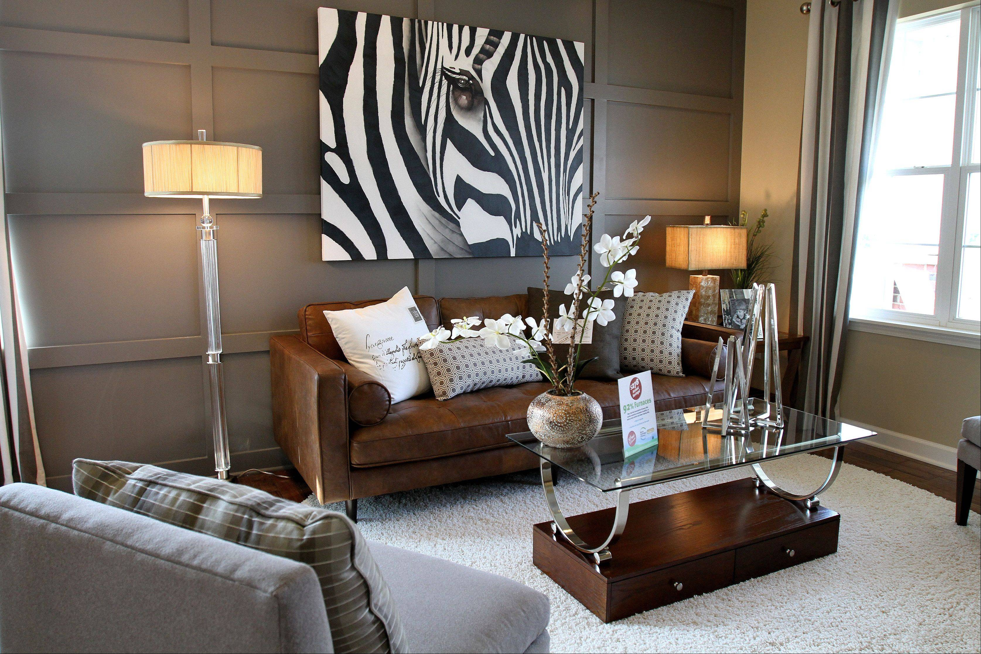 Gray, a hot neutral color this year, was used in the living room in the Edgar model at River Hills in Bolingbrook. Artwork is another way to change the look of a room.