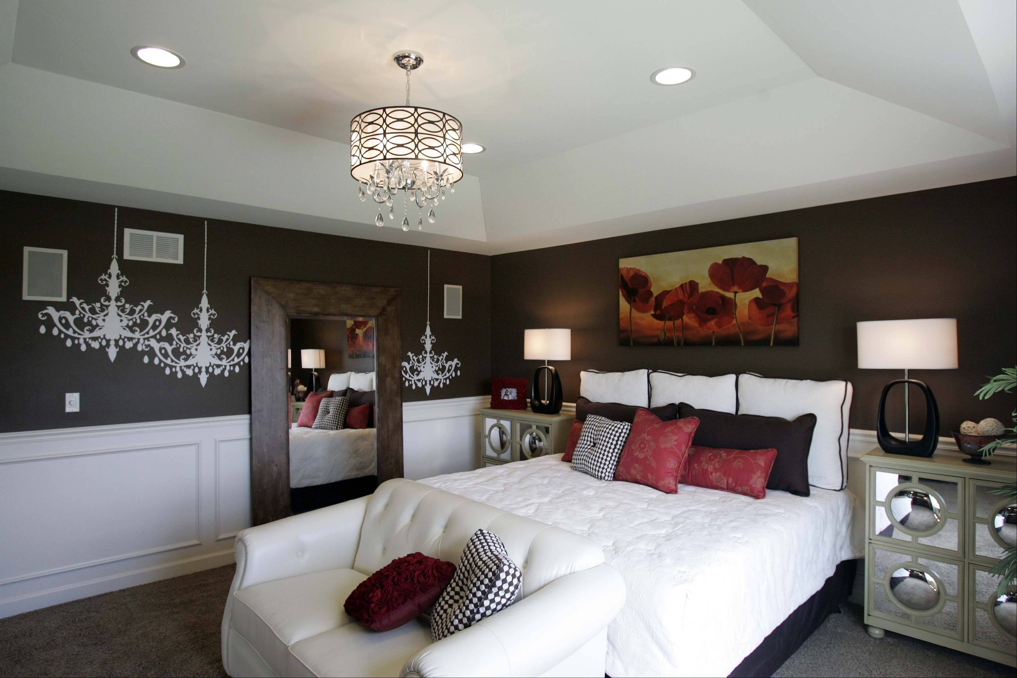 A chandelier hangs in the master bedroom of the Regency model at Regency Estates in St. Charles.