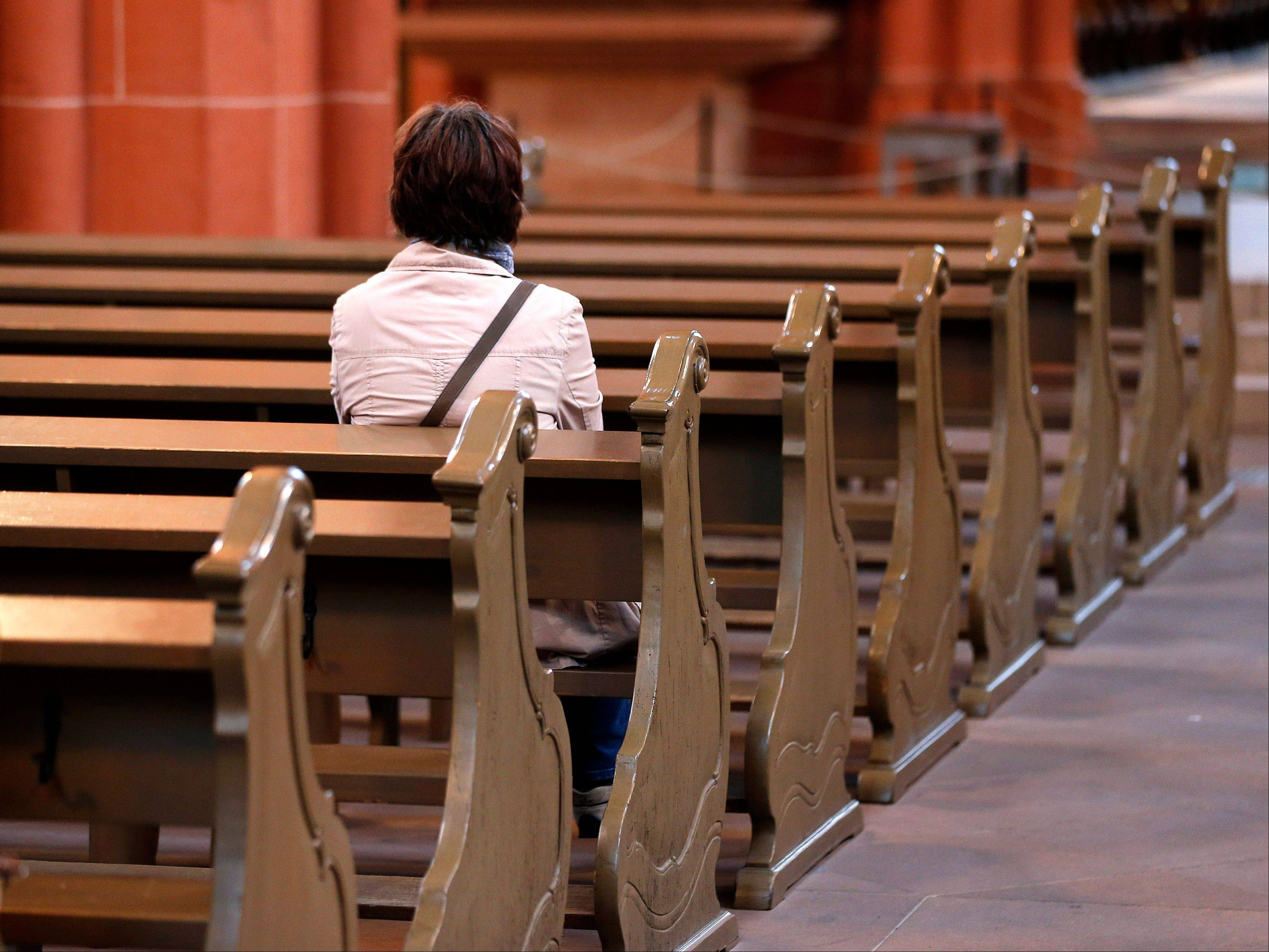 Associated PressA woman sits on a bench Thursday in the cathedral of Frankfurt, Germany. A decree issued last week by the country's bishops cast a spotlight on the longstanding practice in Germany and a handful of other European countries in which governments tax registered believers and then hand over the money to the religious institutions.