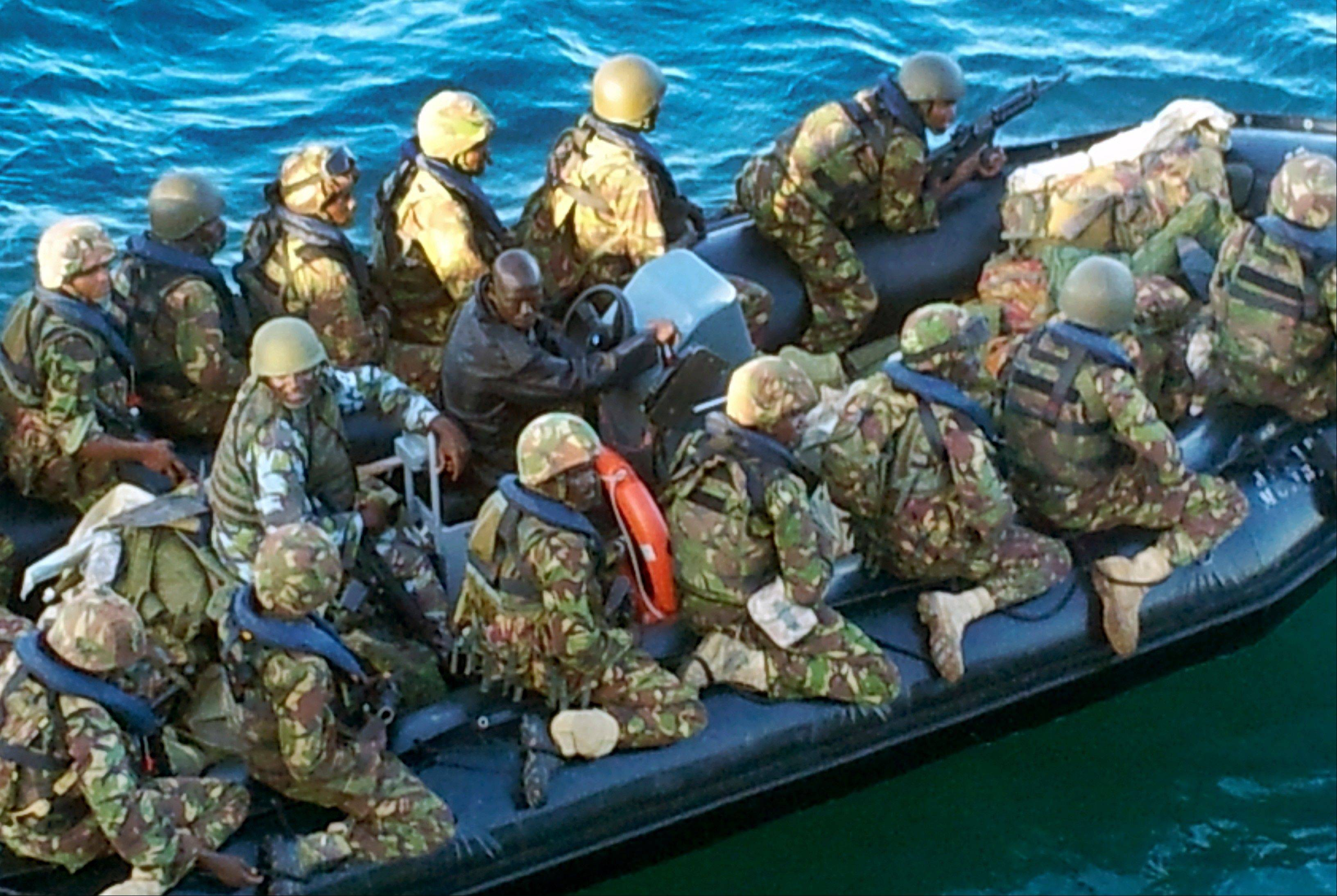This undated photo provided by Kenya's Ministry for Defence on Friday,shows Kenya Defence Forces troops at an undisclosed location in Kenya, engaged in recent preparations for an assault on the Somali port city of Kismayo.