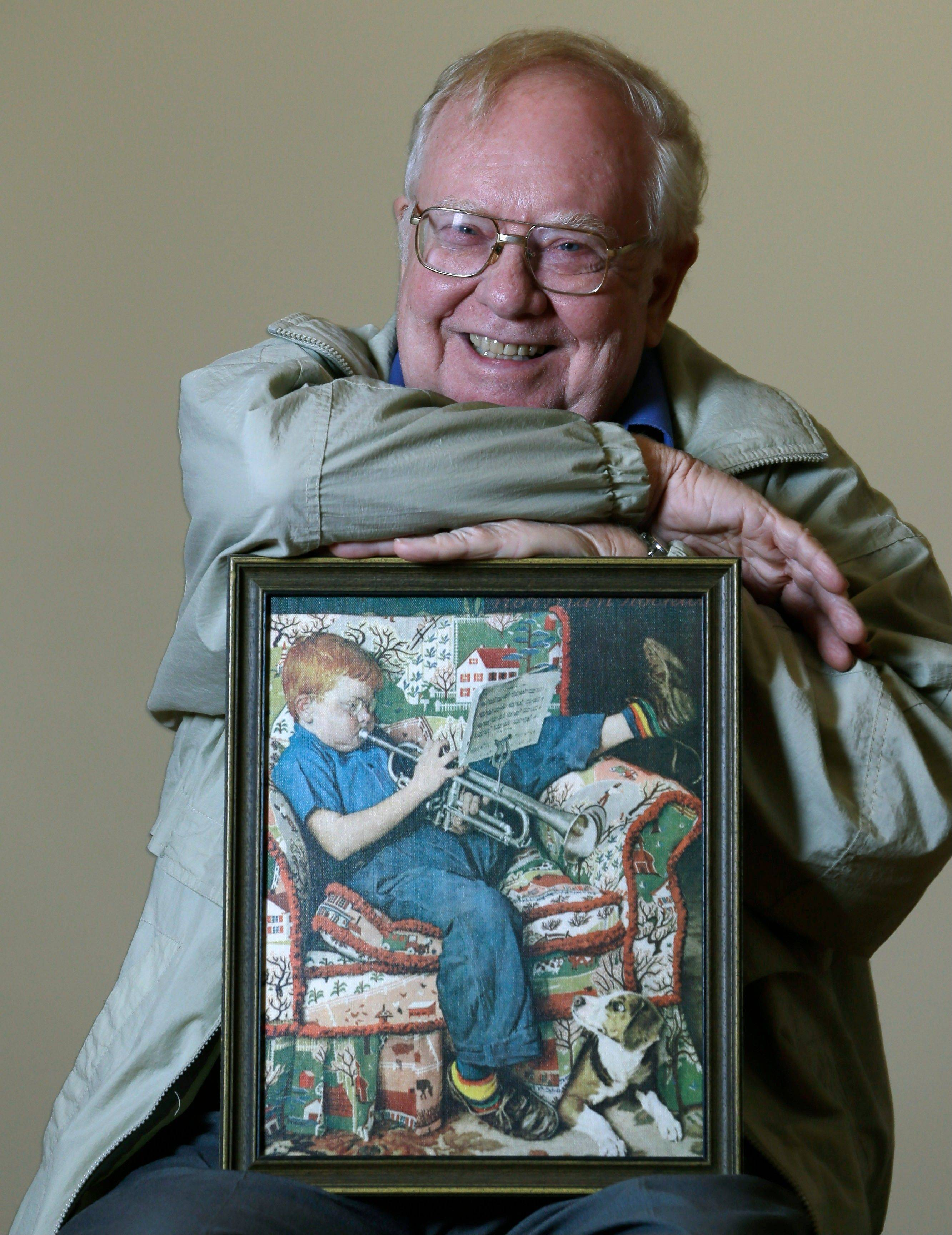 Associated PressTom Paquin of North Bennington, Vt., poses Friday with a 1950 Saturday Evening Post cover illustration by Norman Rockwell for which he modeled, at the Bennington Museum in Bennington, Vt.