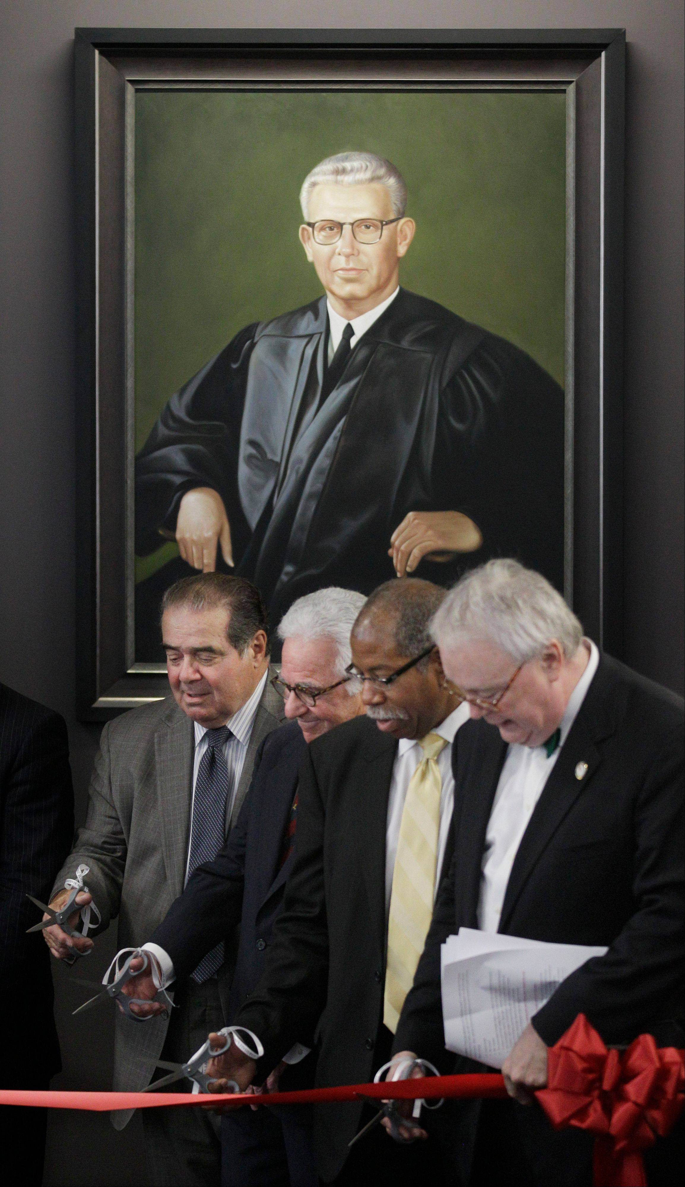 From left, Supreme Court Justice Antonin Scalia, board President Leonard F. Amari, Associate Dean Rory D. Smith and Dean John E. Corkery take part in a ribbon cutting Friday during ceremonies naming a courtroom at The John Marshall Law School in Chicago after former Supreme Court Justice Arthur J. Goldberg, who's portrait hangs behind them.