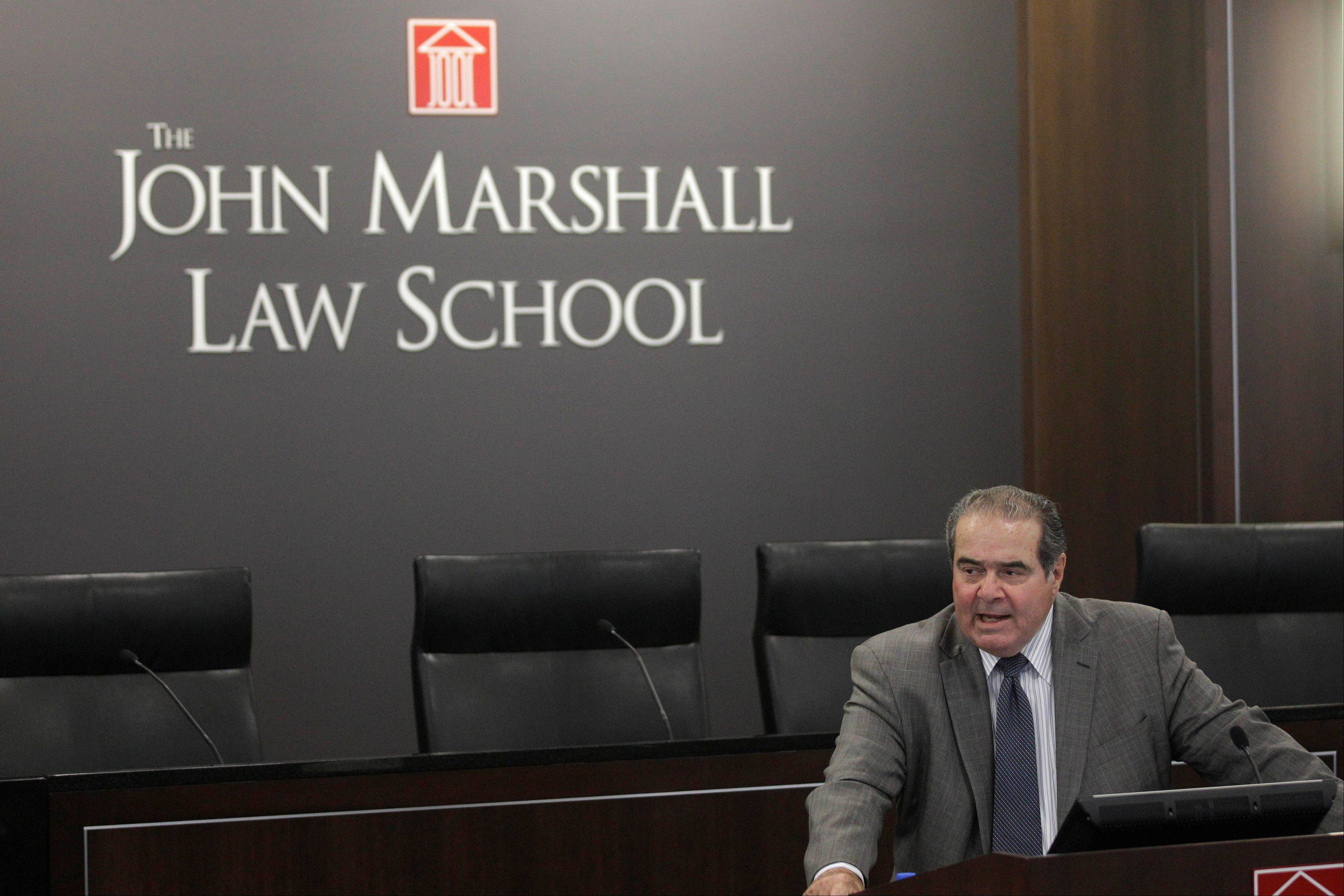 Supreme Court Justice Antonin Scalia speaks Friday during a ceremony naming a courtroom at The John Marshall Law School in Chicago after former Supreme Court Justice Arthur J. Goldberg.