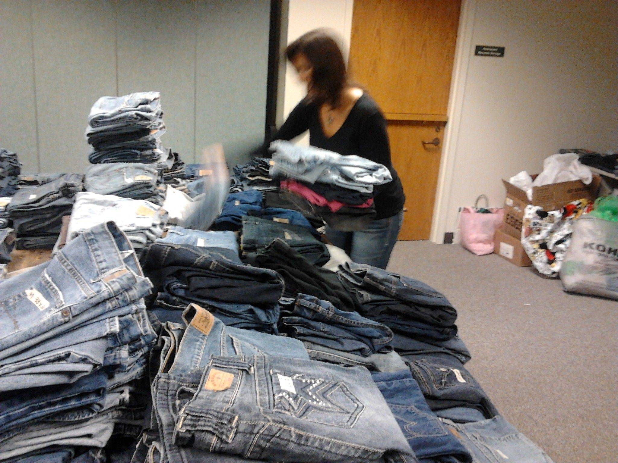 Susan Miller led a volunteer effort to provide about 1,000 pairs of donated jeans at no cost to those in need who visited the ministry center Thursday night at Lake Zurich's St. Francis de Sales Parish.