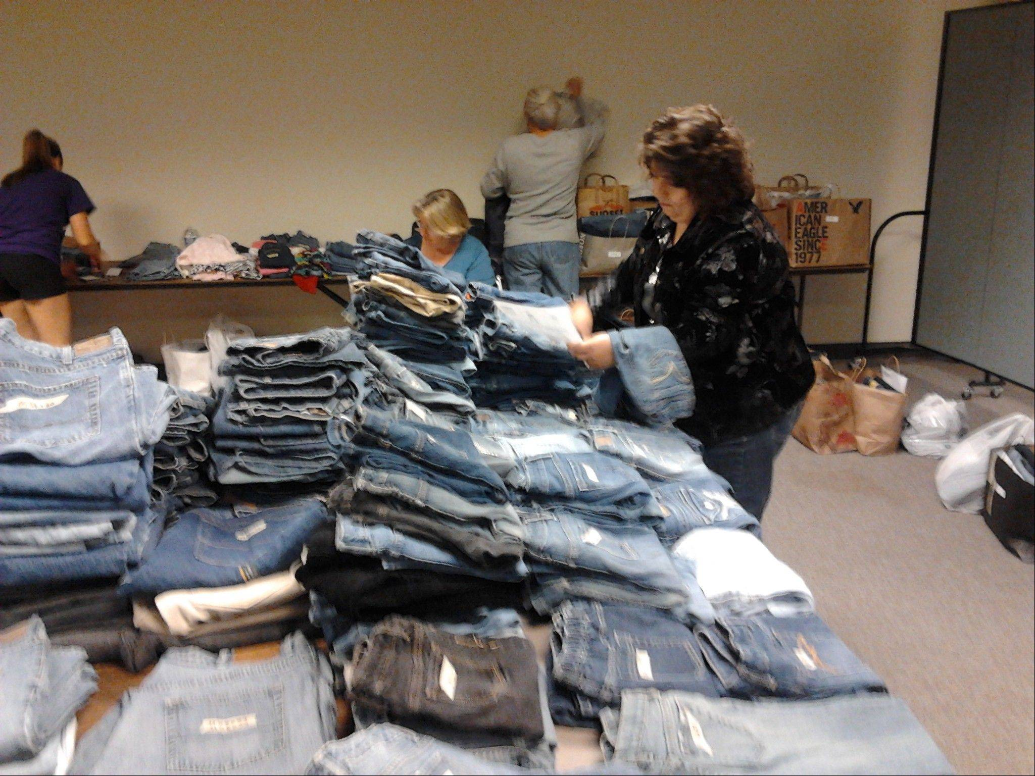Rose Weismann was among the volunteers who distributed about 1,000 pairs of donated jeans at no cost to those in need at a weekly food pantry at St. Francis de Sales Parish in Lake Zurich.