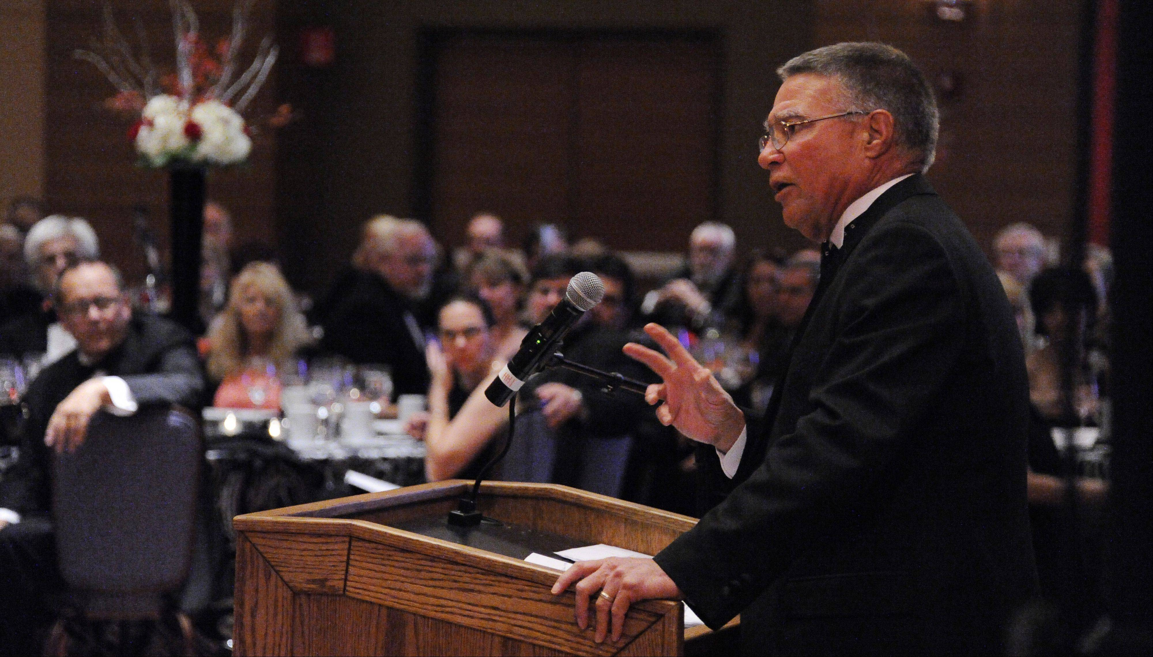 Harper President Kenneth Ender speaks to the more than 400 people at the President's Ball gala fundraiser for the Harper College Educational Foundation on Sept. 22.