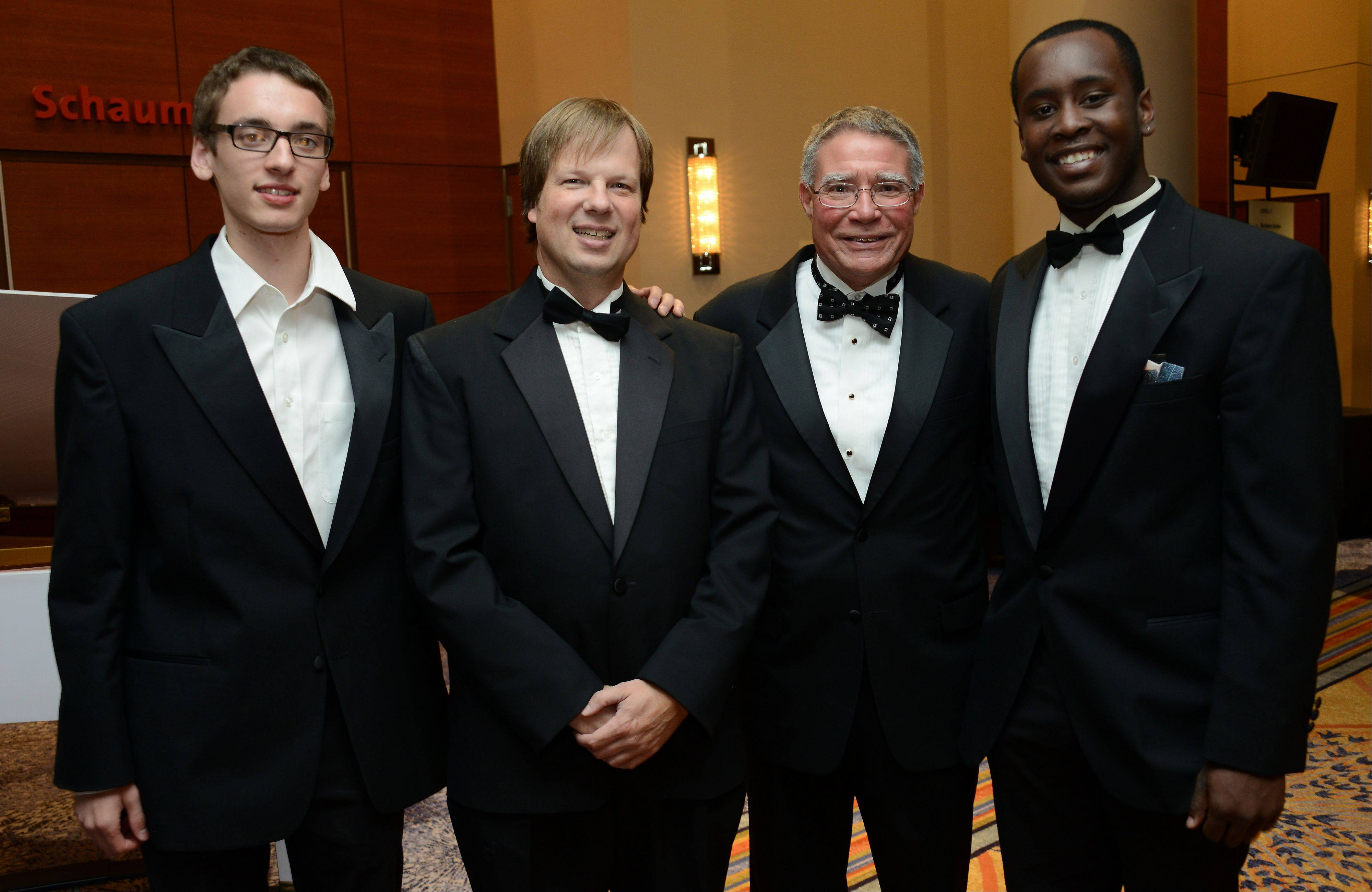 College President Kenneth Ender, third from left, join members of the Harper College Jazz Lab Band, from left, Conor Roe of Arlington Heights, Ken Spurr of Elmhurst and Jalen Little of Schaumburg, far right.