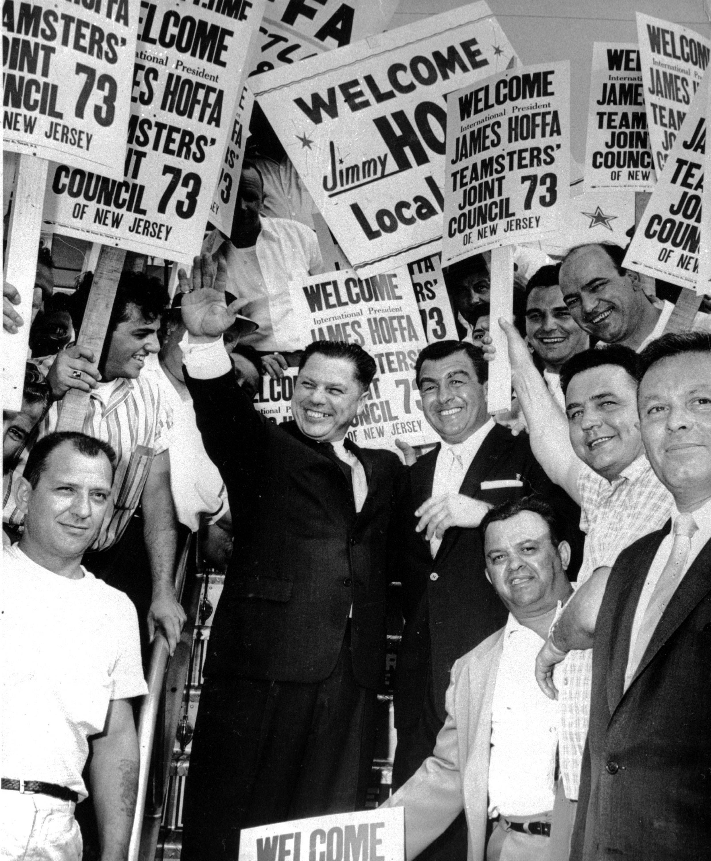 This undated photo shows Teamsters Union President James R. Hoffa, left, stands with Anthony Provenzano, right, and fellow union members during Hoffa's visit to New Jersey. A self-described mafia murderer who served prison time with Hoffa told a U.S. Senate committee that the teamsters boss was killed at Provenzano's orders.