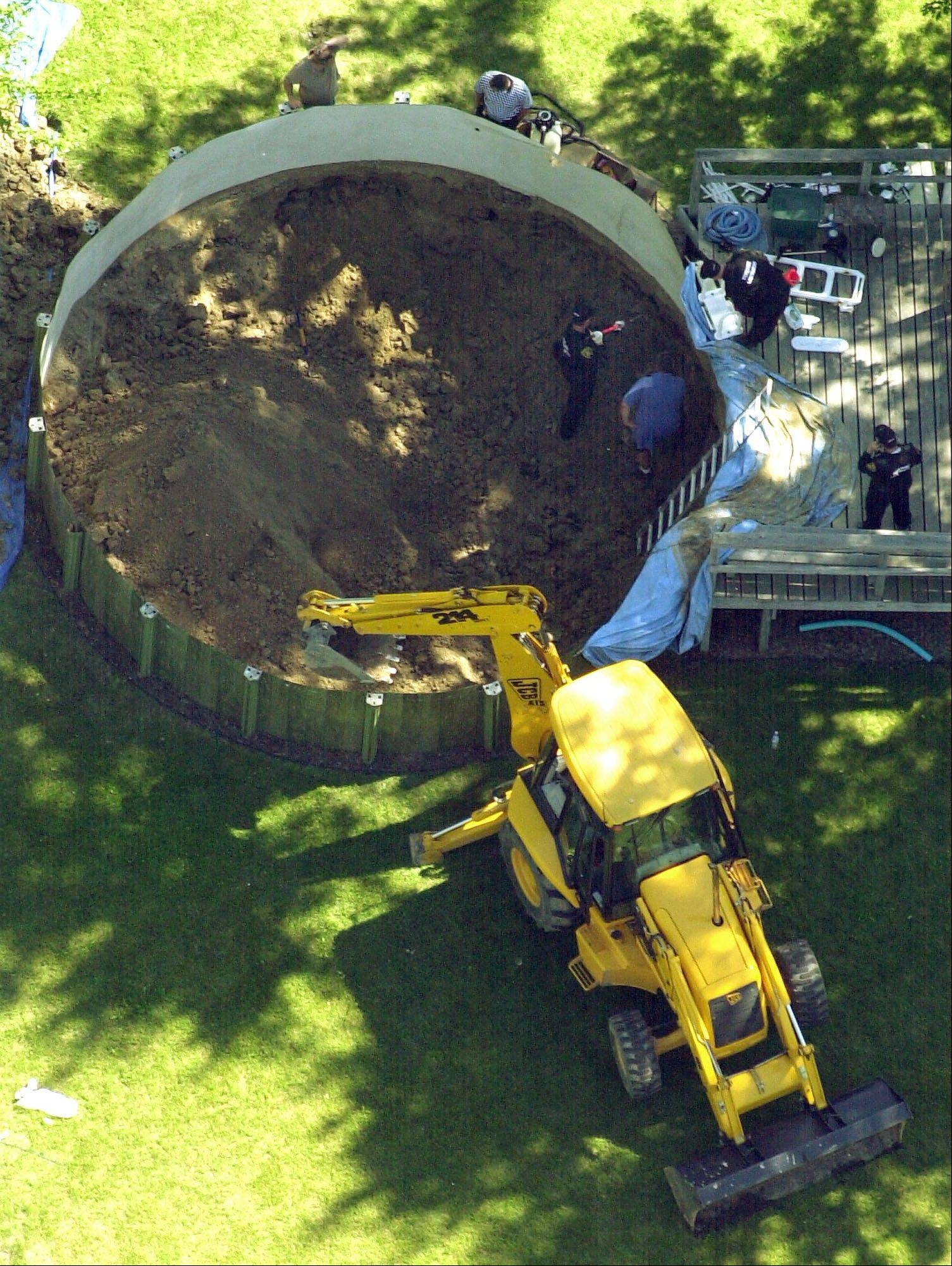 July 16, 2003: Authorities search under a backyard pool in Hampton Township, Mich., for evidence linked to the disappearance of ex-teamster boss Jimmy Hoffa.