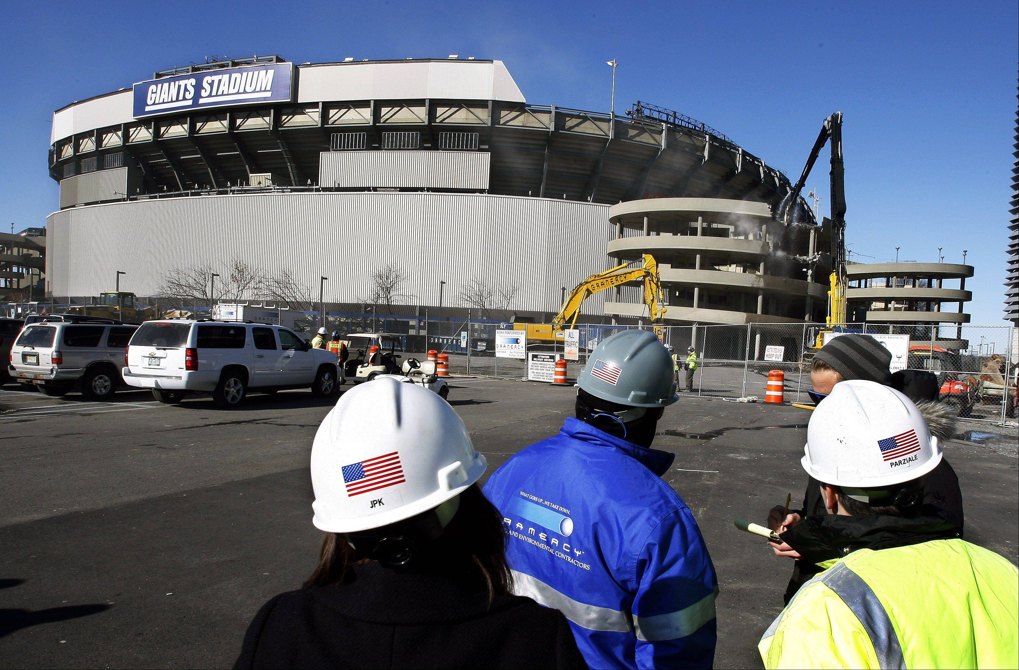 "Feb. 4, 2010: Workers watch as a machine begins the demolition of Giants Stadium, in East Rutherford, N.J. Self-described hit man Donald ""Tony the Greek"" Frankos claims ex-Teamsters boss Jimmy Hoffa was buried under Giants Stadium, but the FBI found no evidence to support the claim."