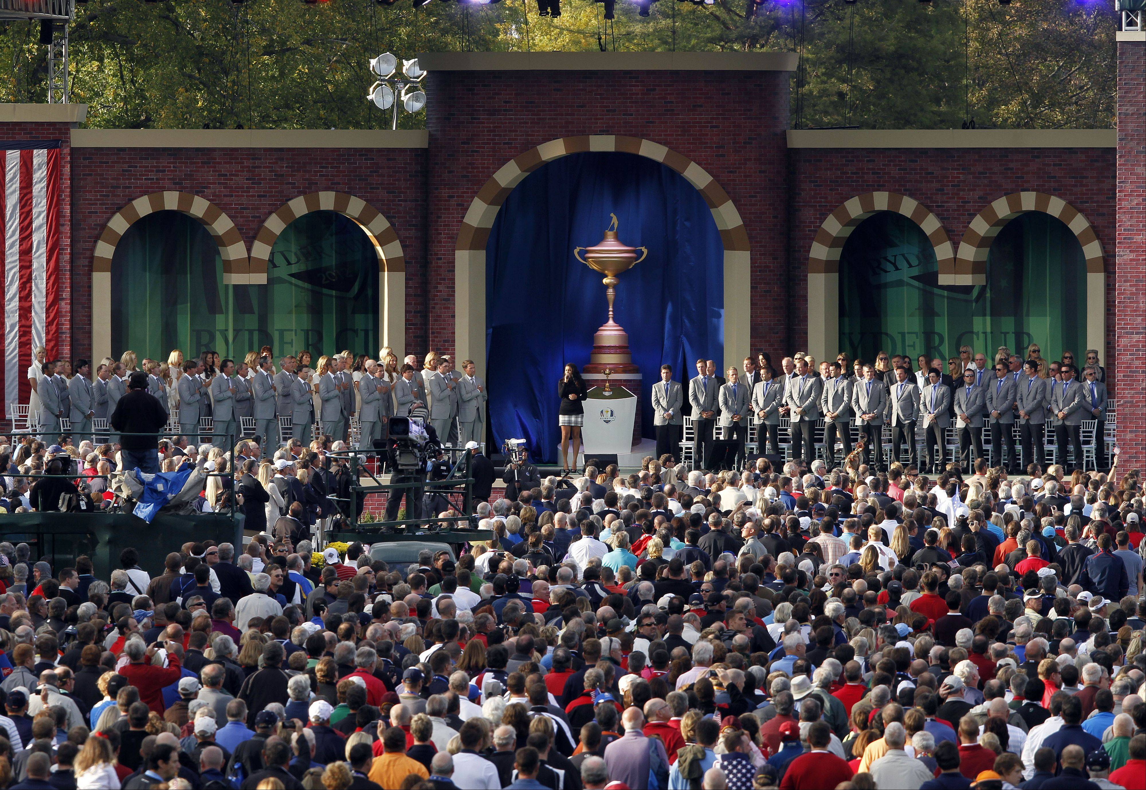 The United States, left, and European teams rise as singing artist Jordin Sparks sings the national anthem as part of the 39th Ryder Cup opening ceremonies yesterday at Medinah Country Club.