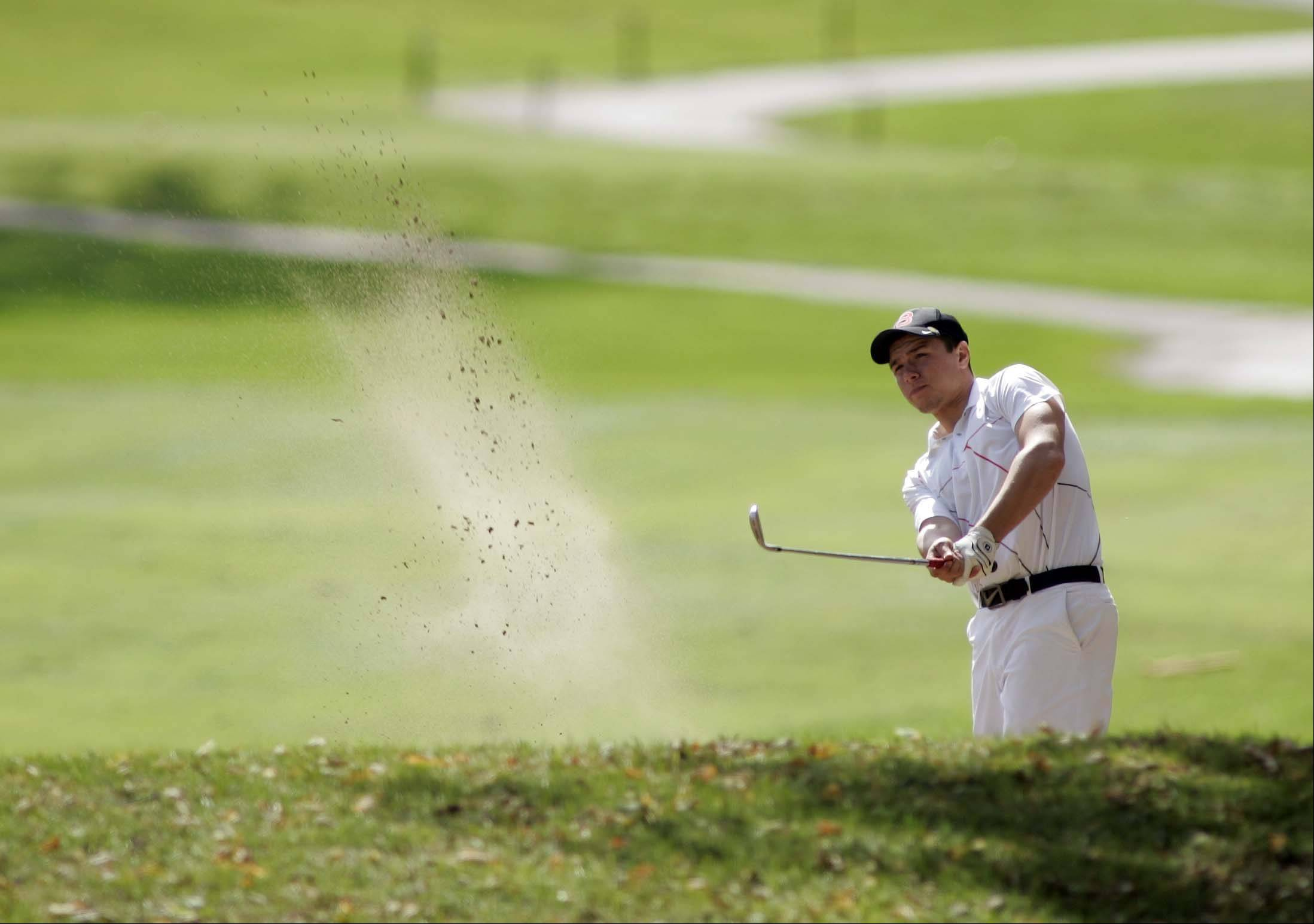 Batavia's Nathan Podraza hits out of the sand on the second hole during the Upstate Eight boys golf tournament Wednesday at St. Andrews Golf & Country Club in West Chicago. The course is open to the public.
