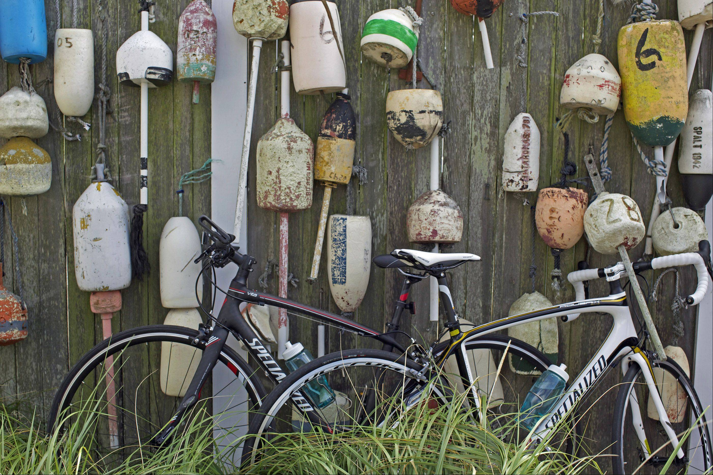 A display of nautical gear hangs on a wall along a Cape Cod road in Woods Hole, Mass. last month.